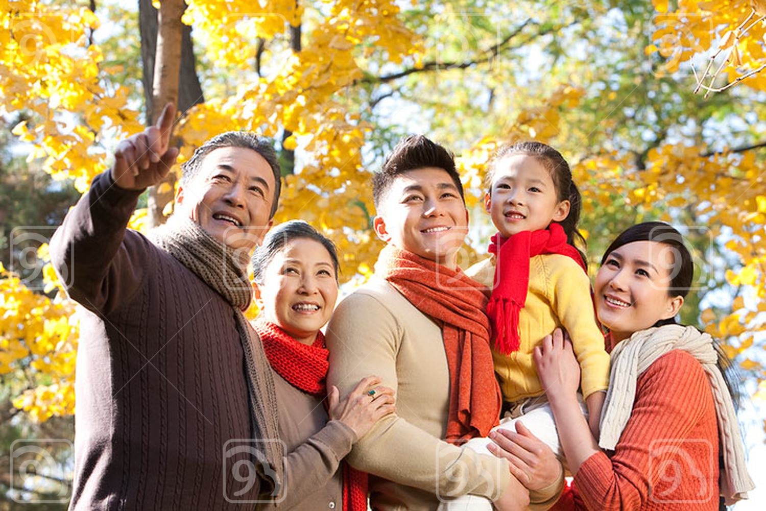 Chinese family in a park in autumn