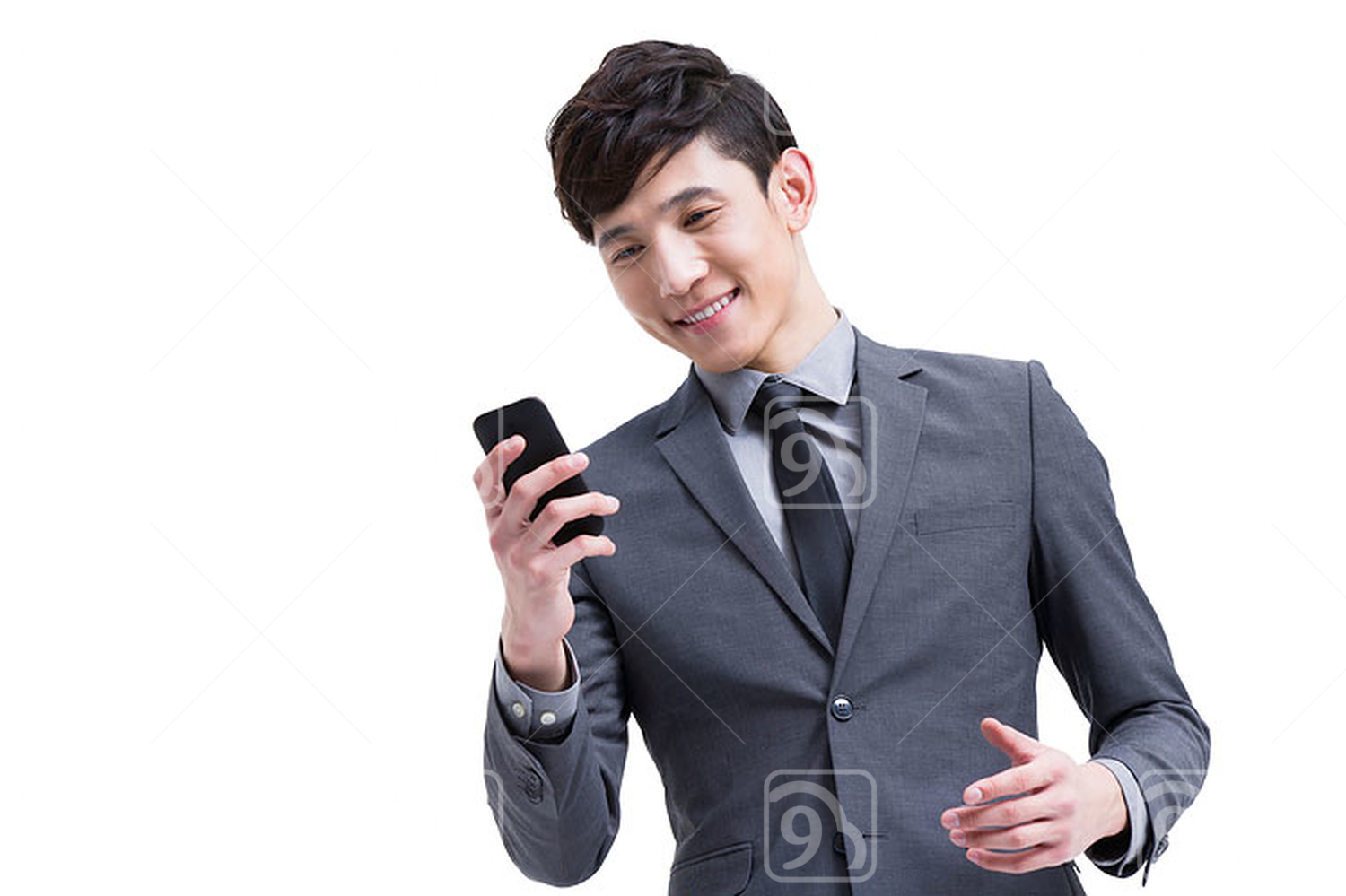 Young Chinese businessman with smart phone