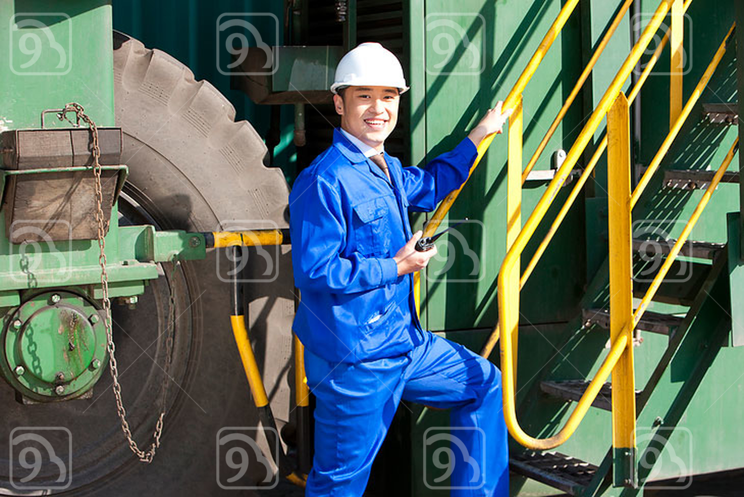 Chinese shipping industry manager with a walkie-talkie going up stairs