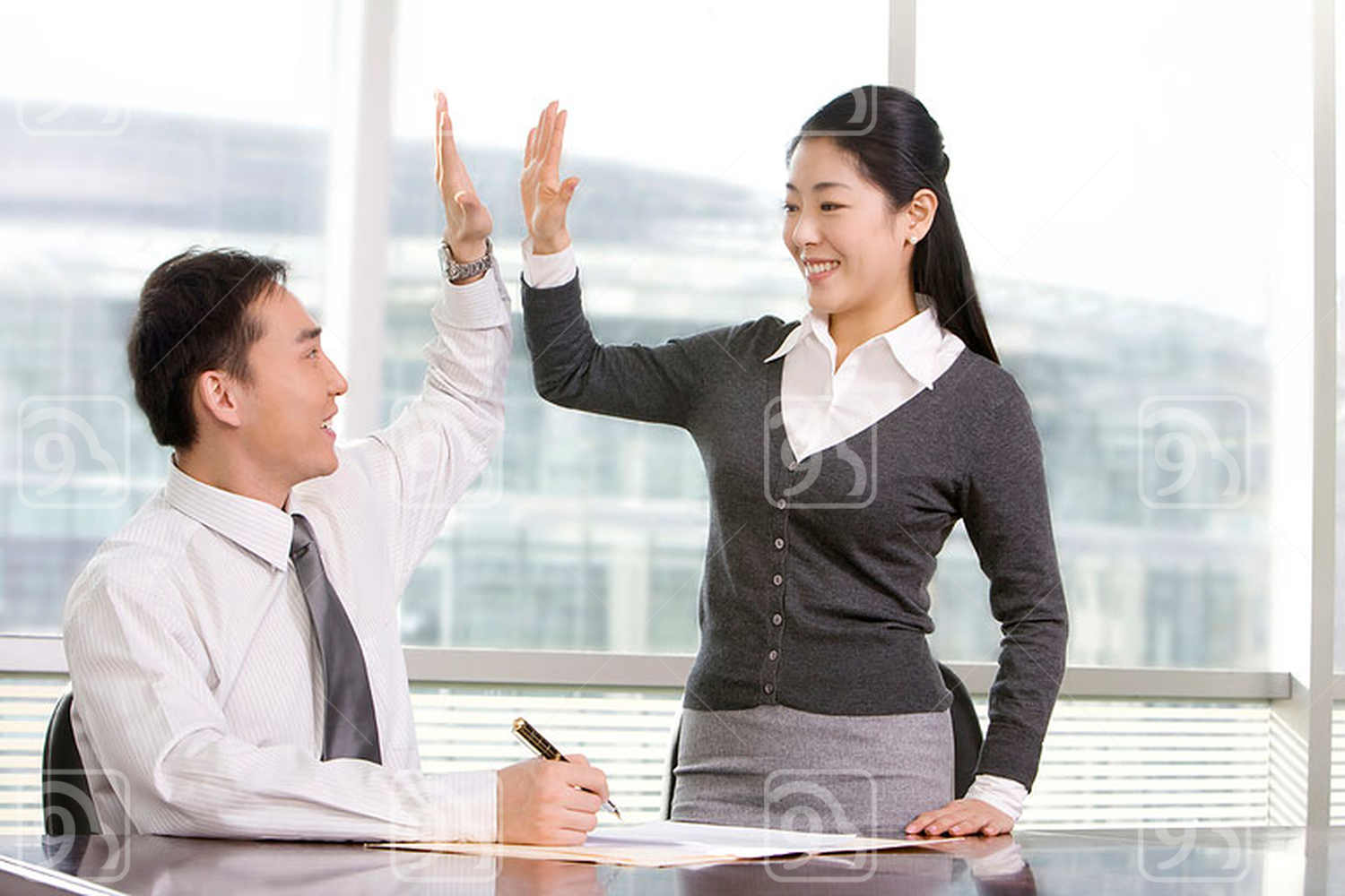 Chinese officemates high-five