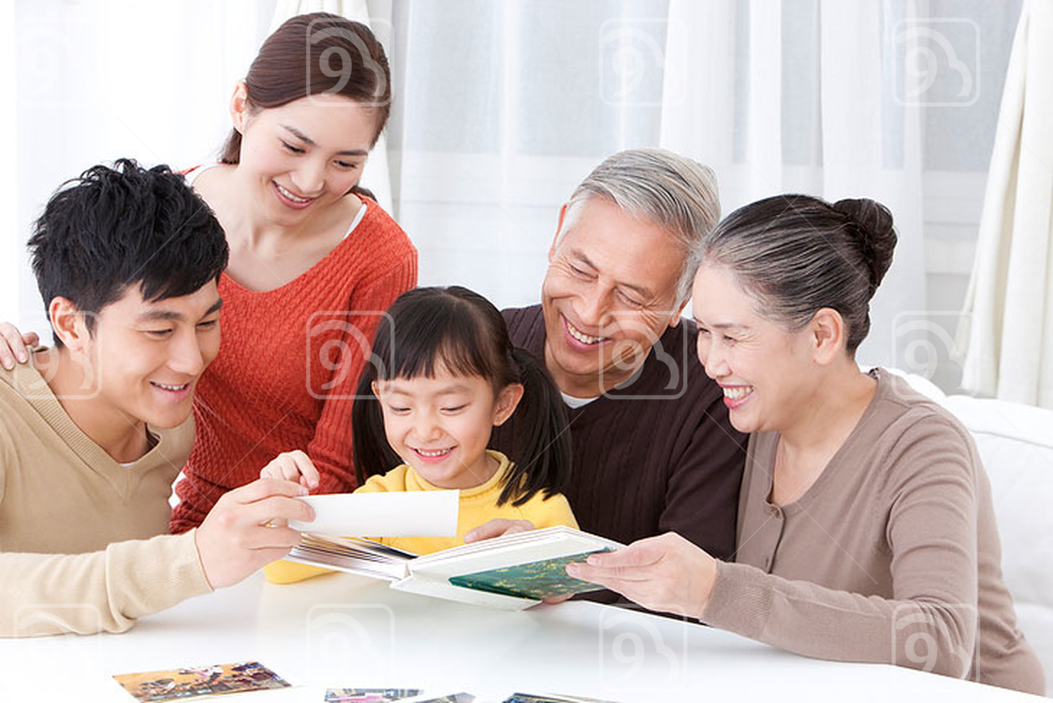 Chinese family looking through family album