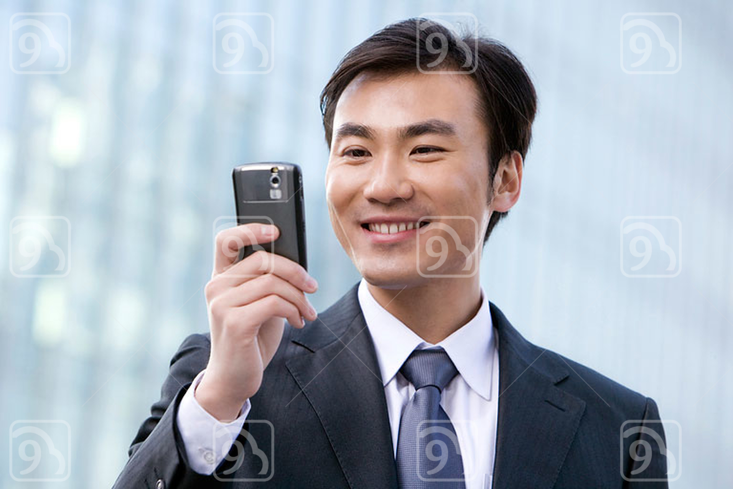 Chinese businessman using cellphone