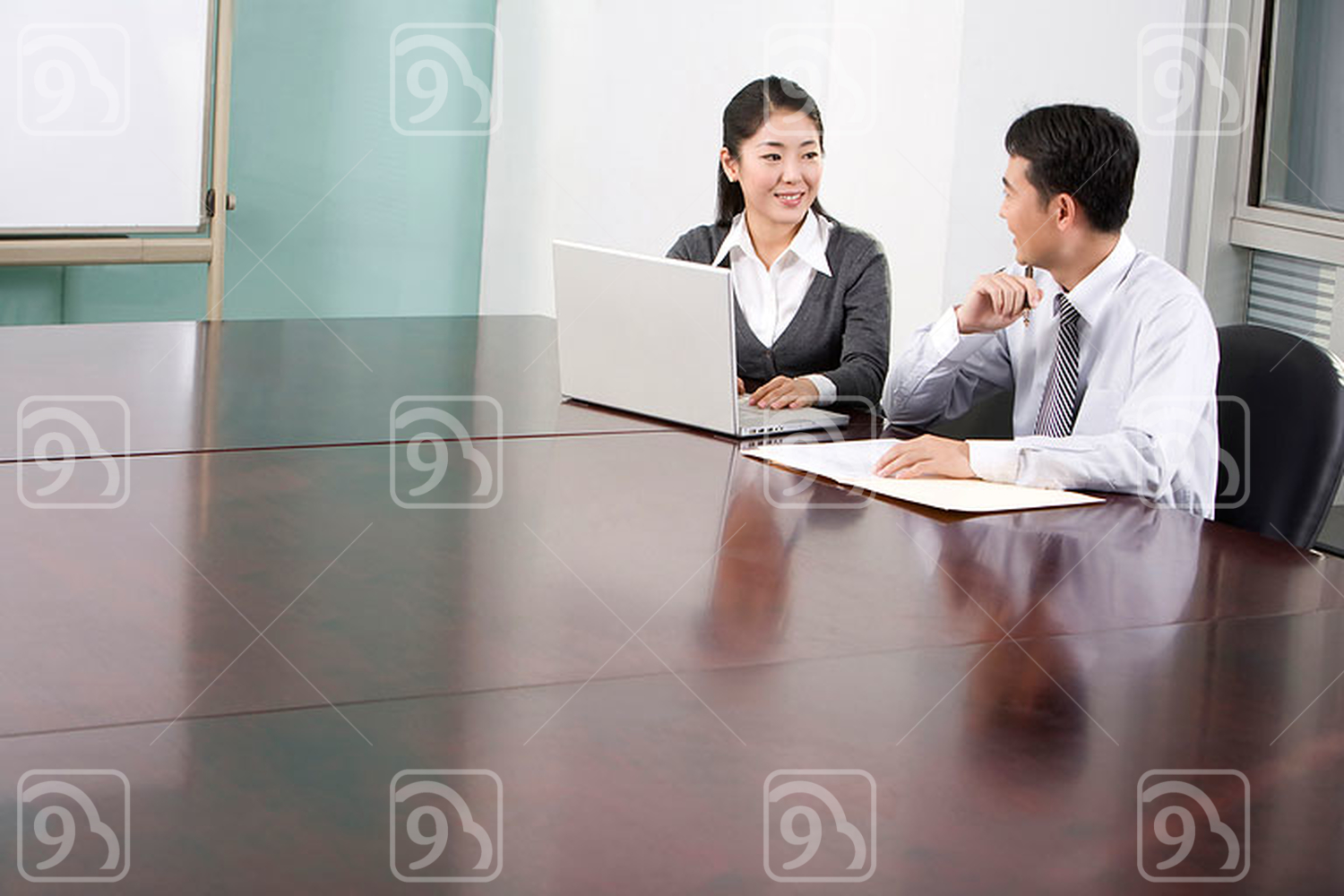 Chinese office workers in the conference room