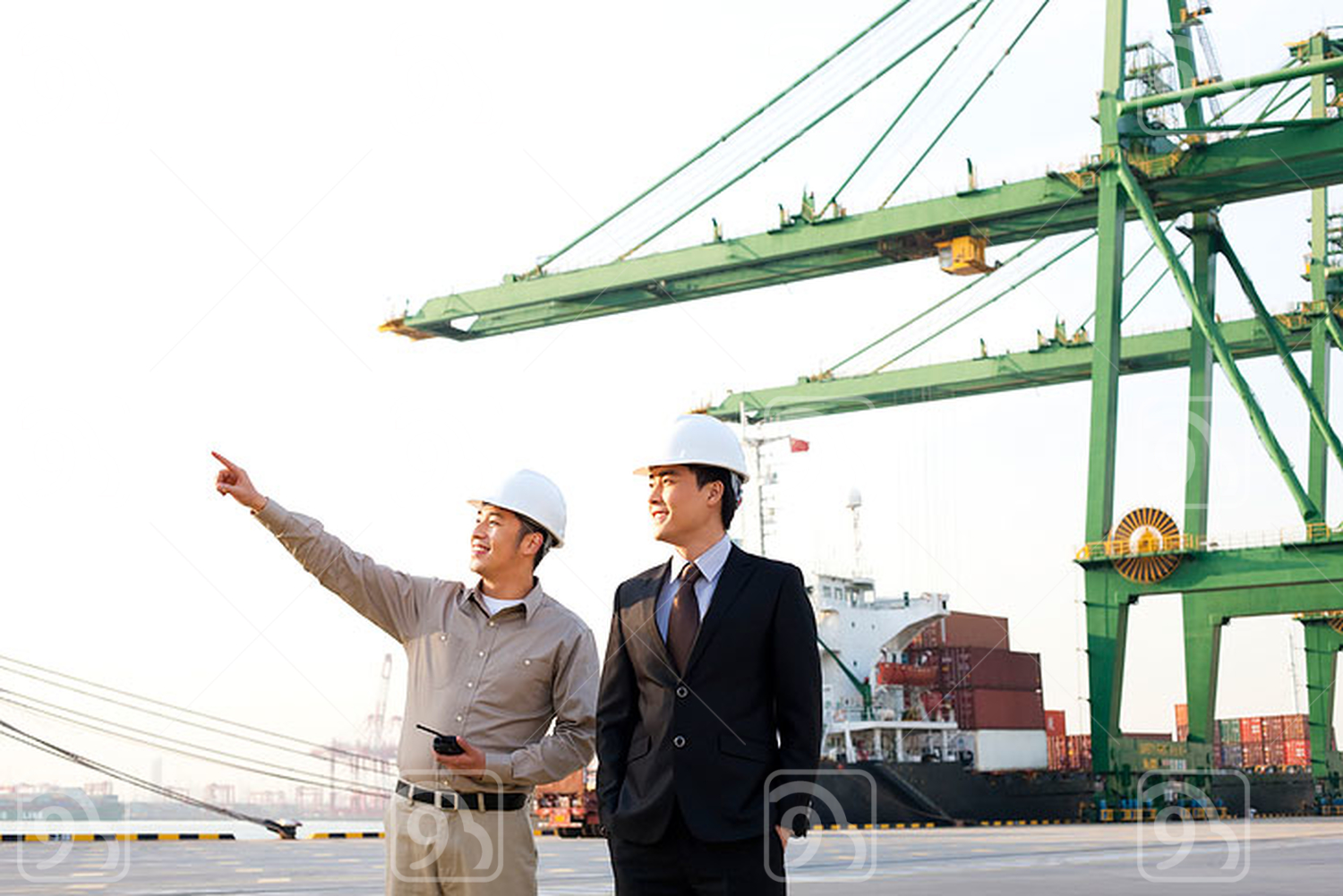Chinese shipping industry worker showing a businessman around the port