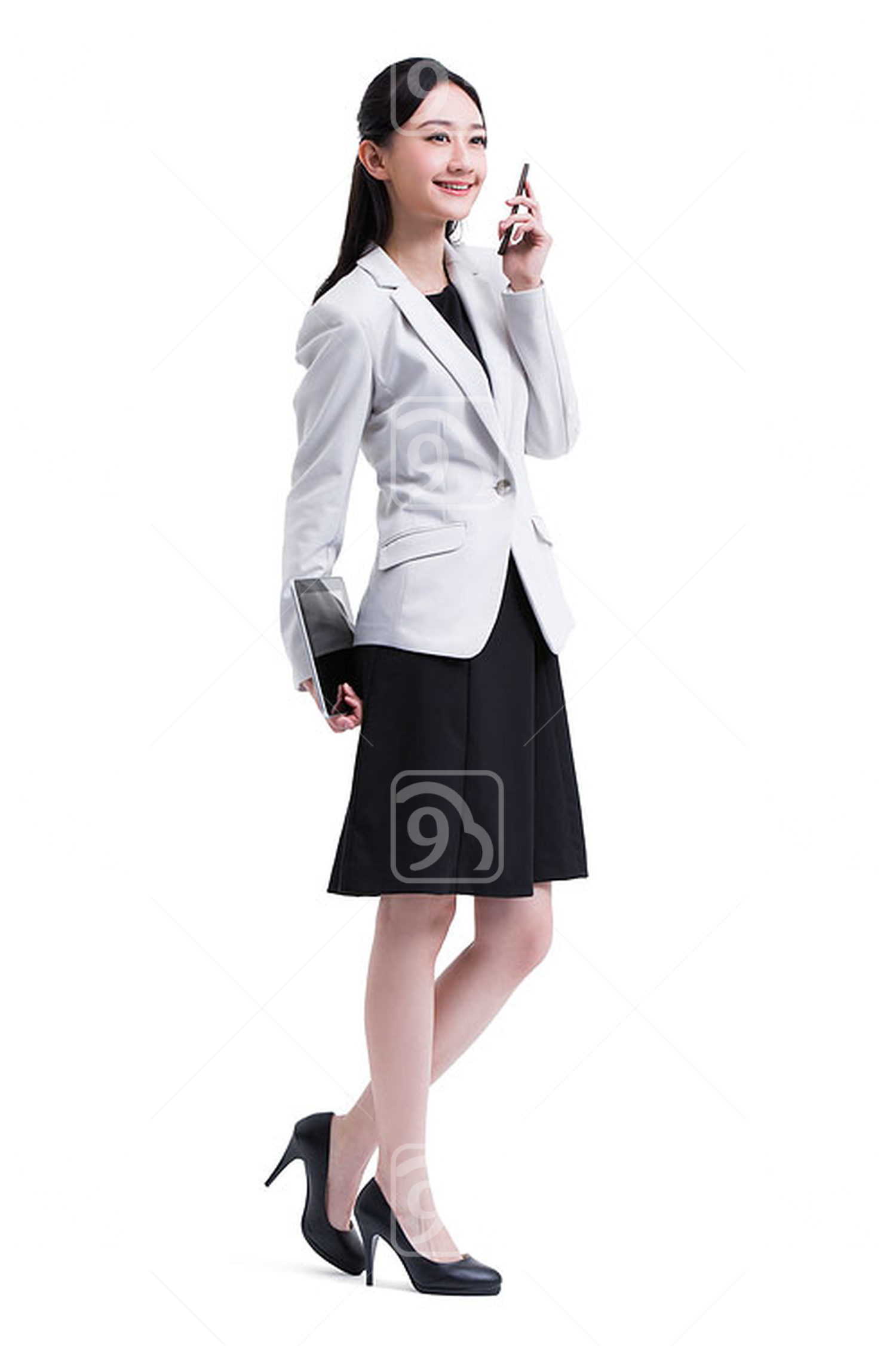 Young Chinese businesswoman with digital tablet and smart phone