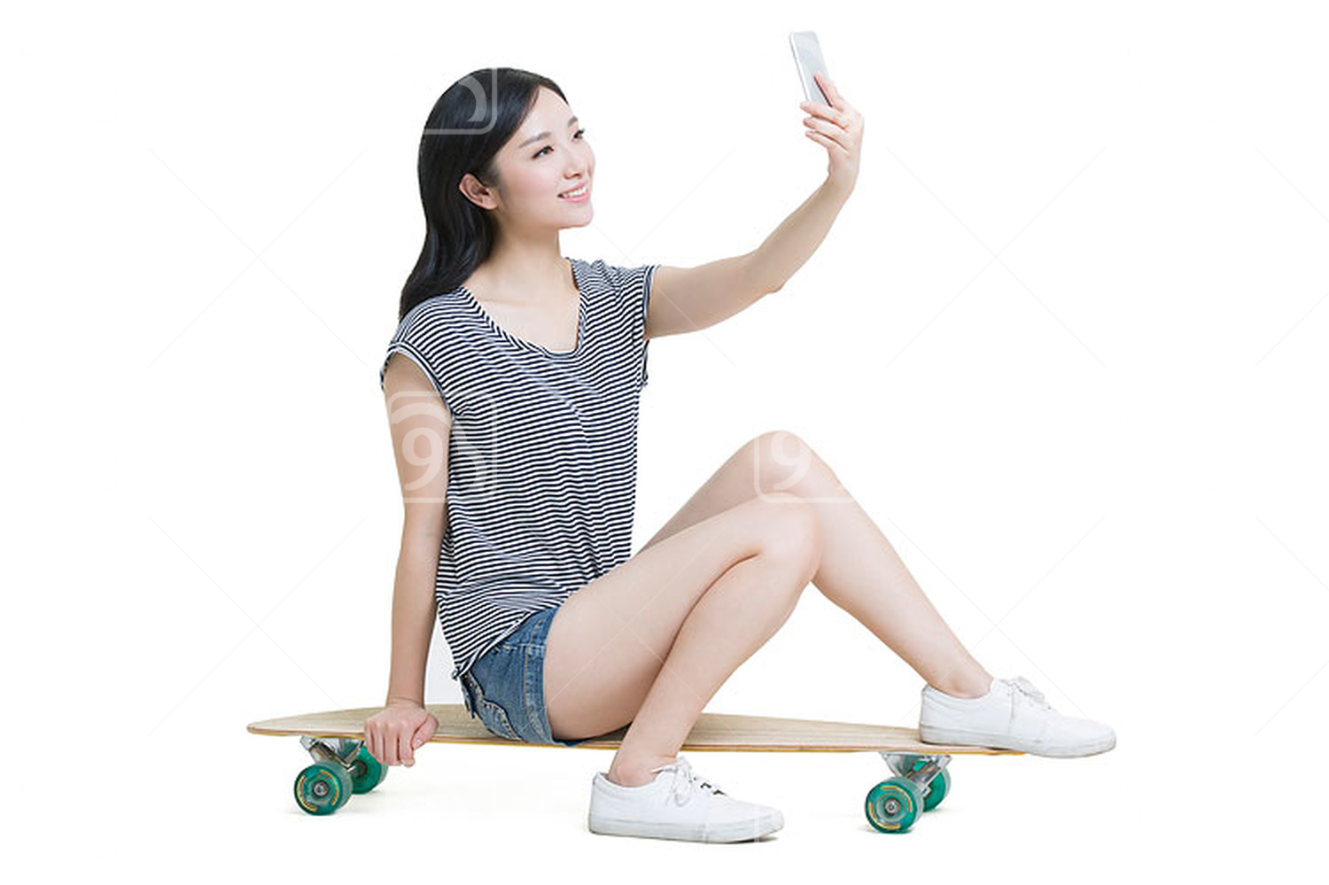Young Chinese woman taking self portrait with a smart phone