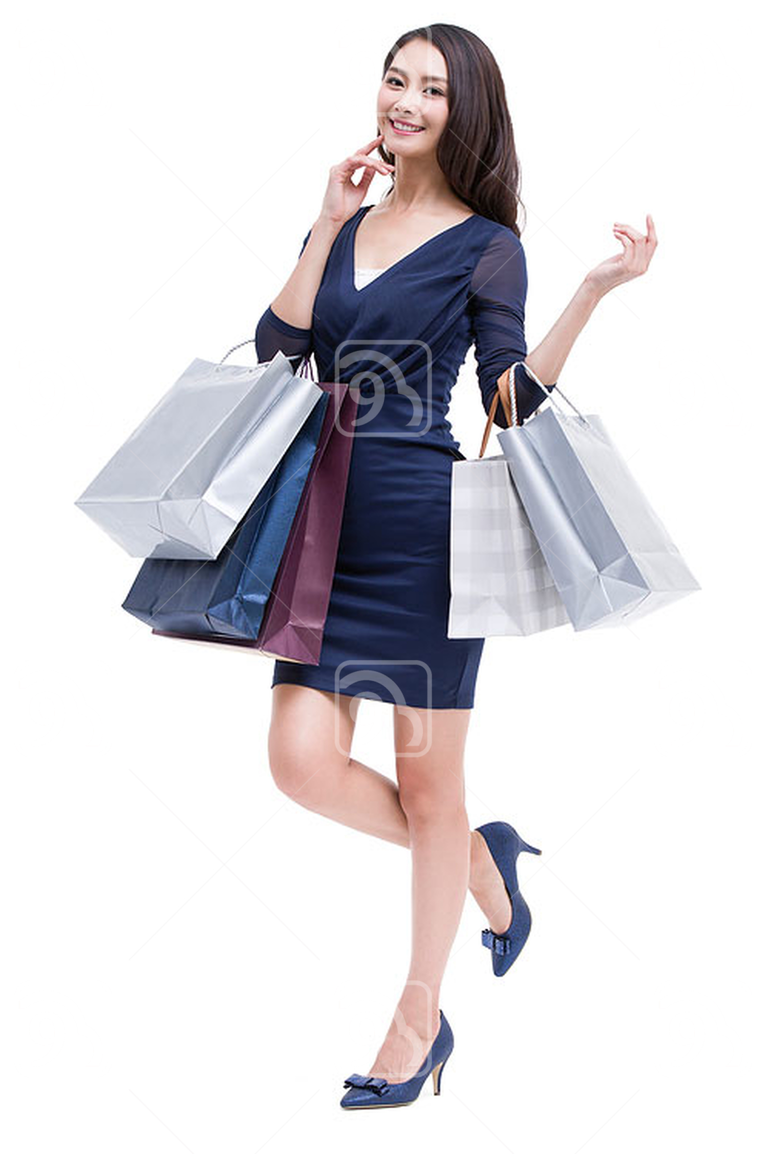 Cheerful young Chinese woman shopping