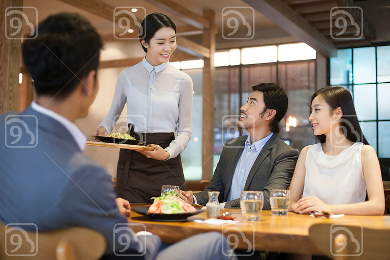 Chinese waitress serving in restaurant