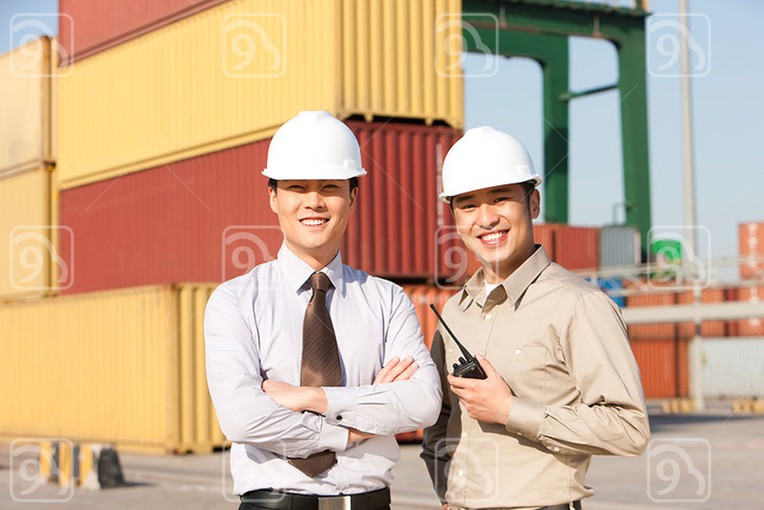 Chinese businessman with shipping industry worker