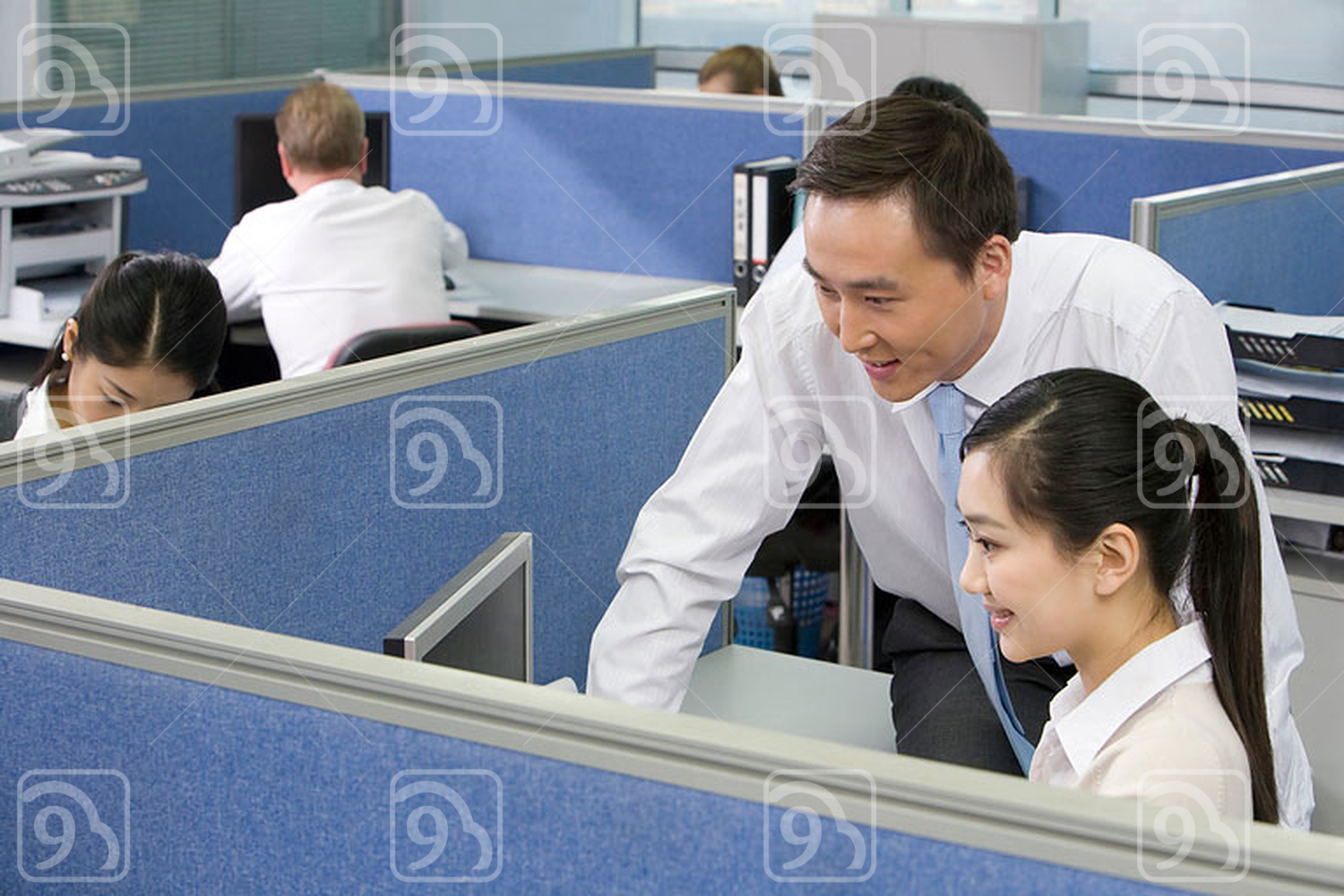 Chinese office workers in cubicles