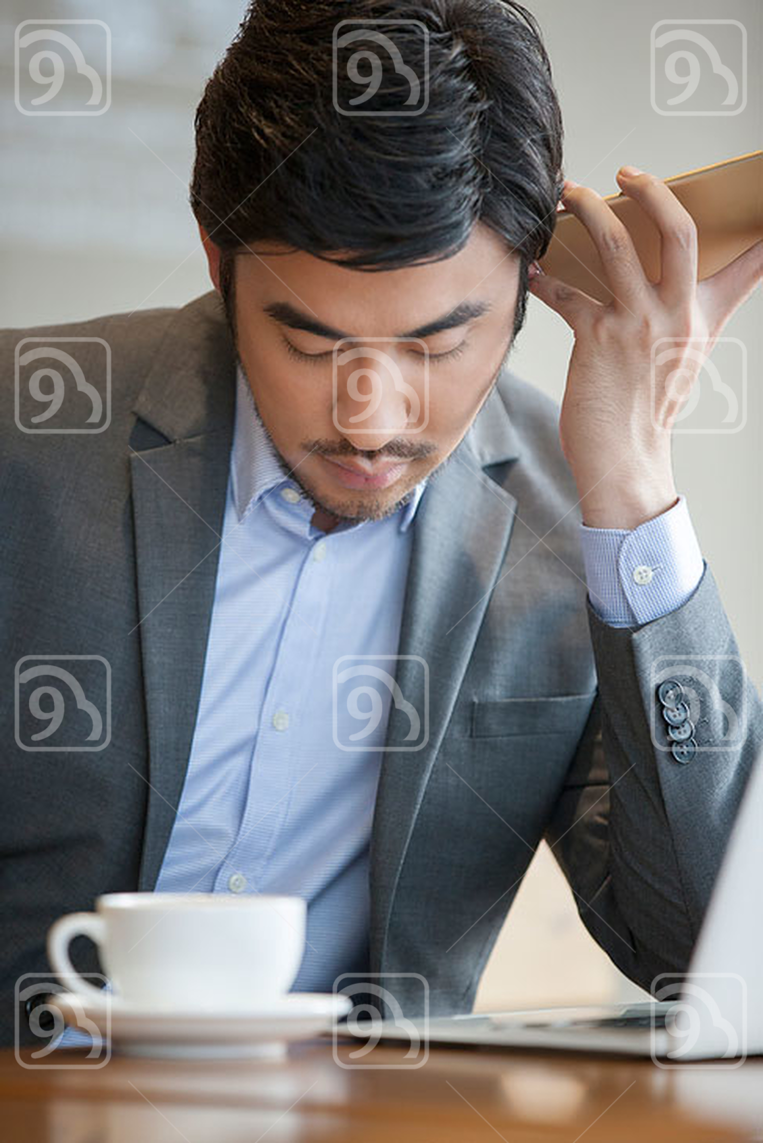 Chinese businessman using smart phone