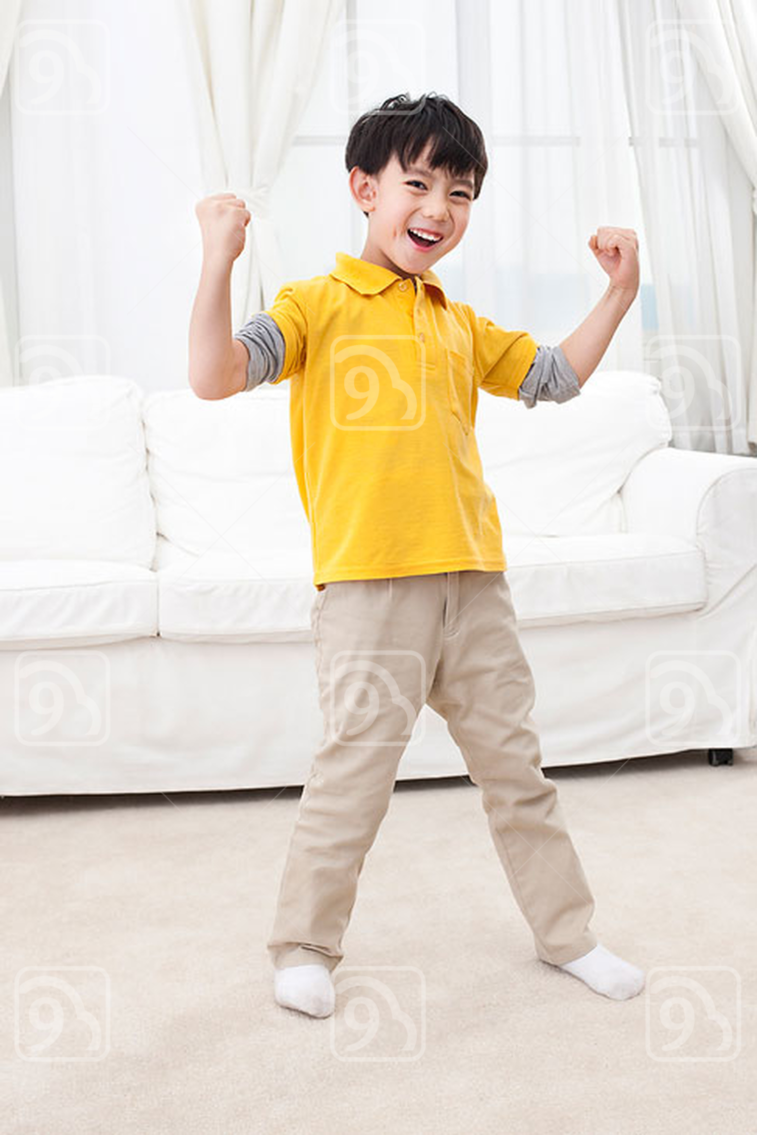 Little Chinese boy showing his strength