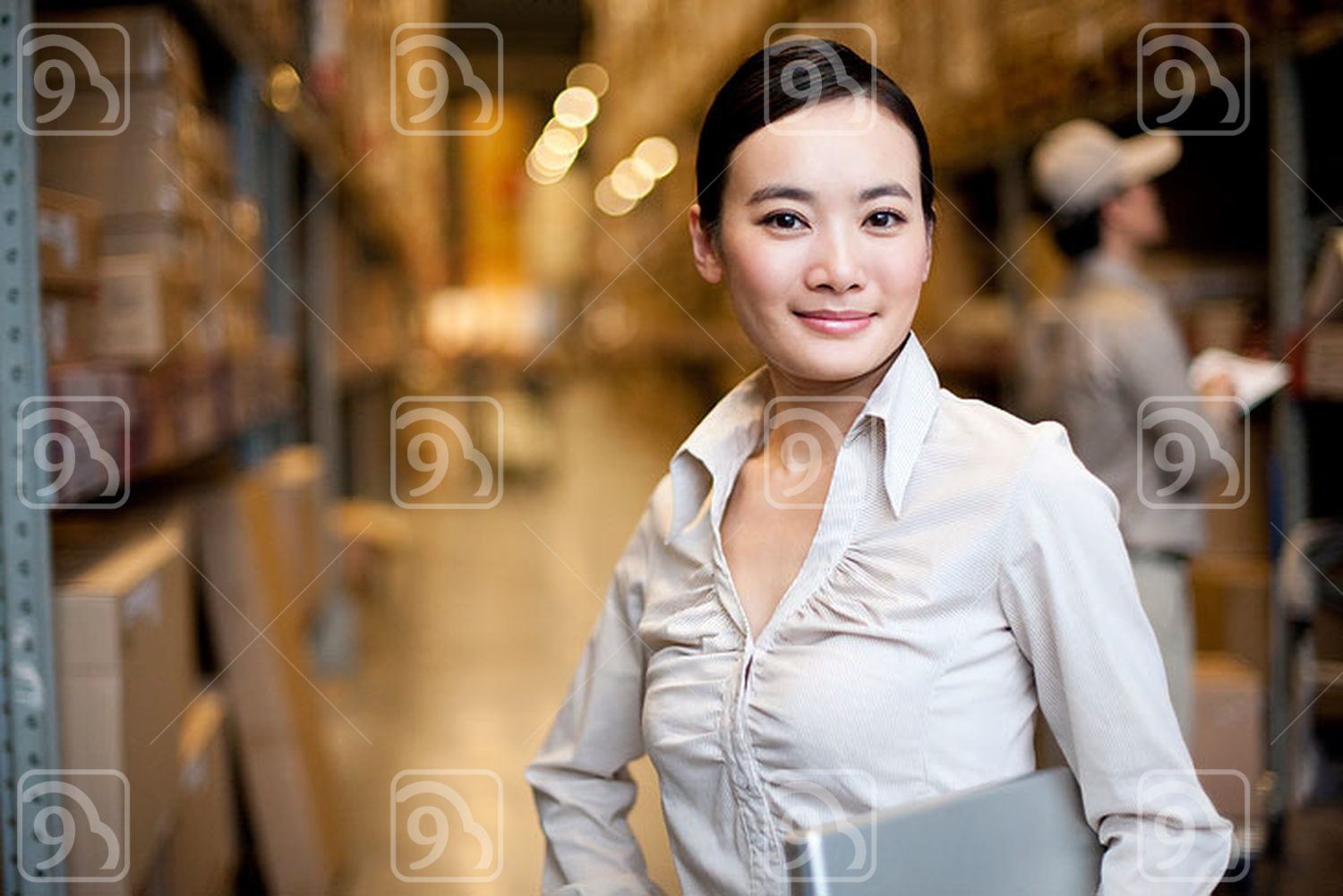 Chinese businesswoman in a warehouse