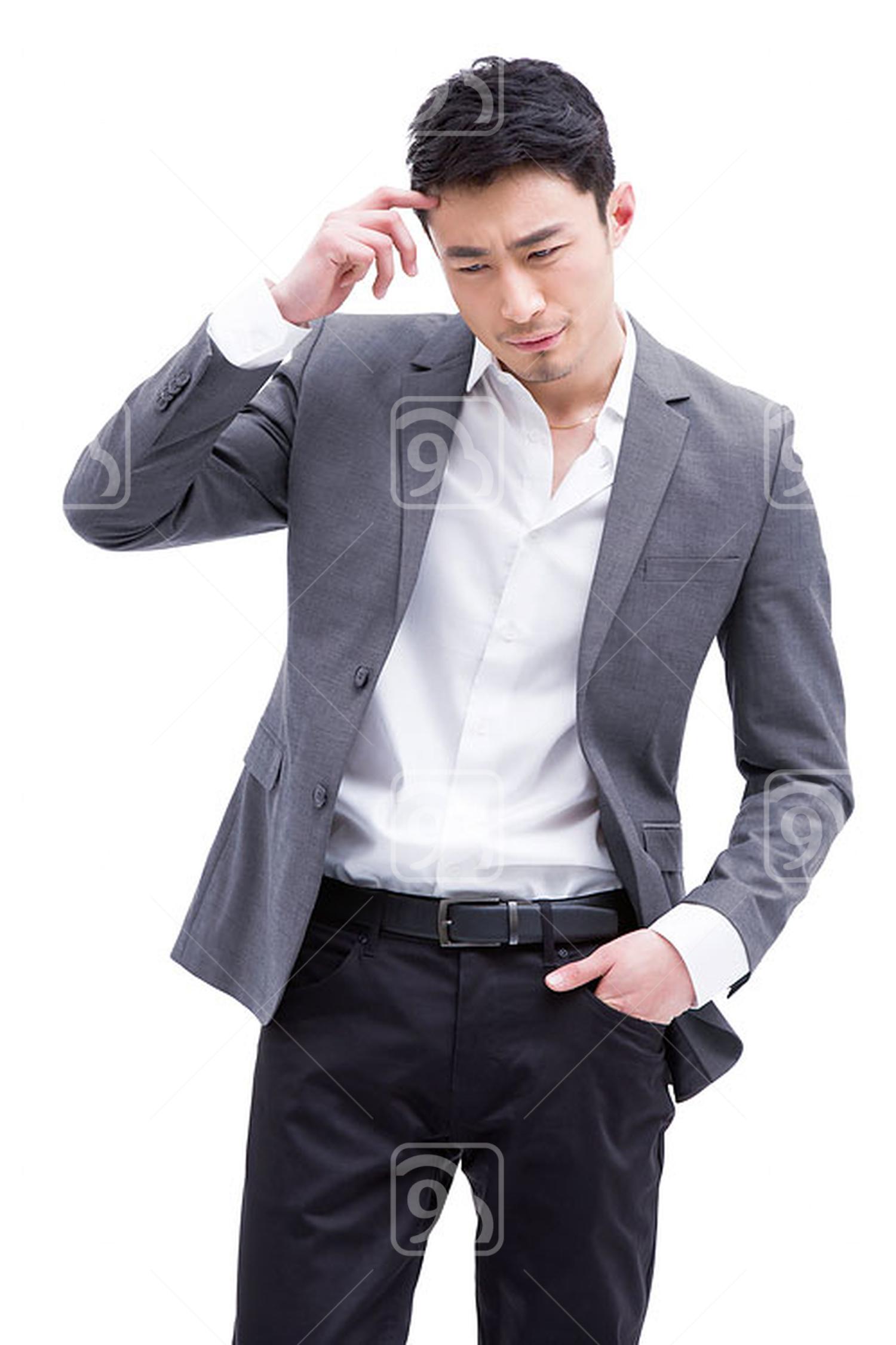 Fashionable Chinese businessman thinking