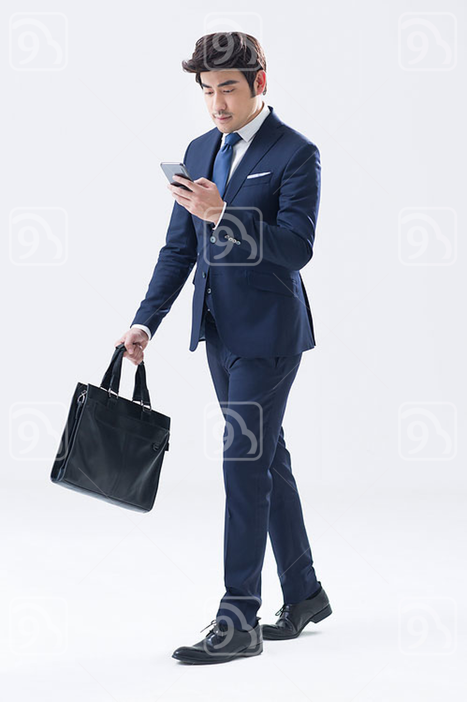 Young Chinese businessman using smart phone