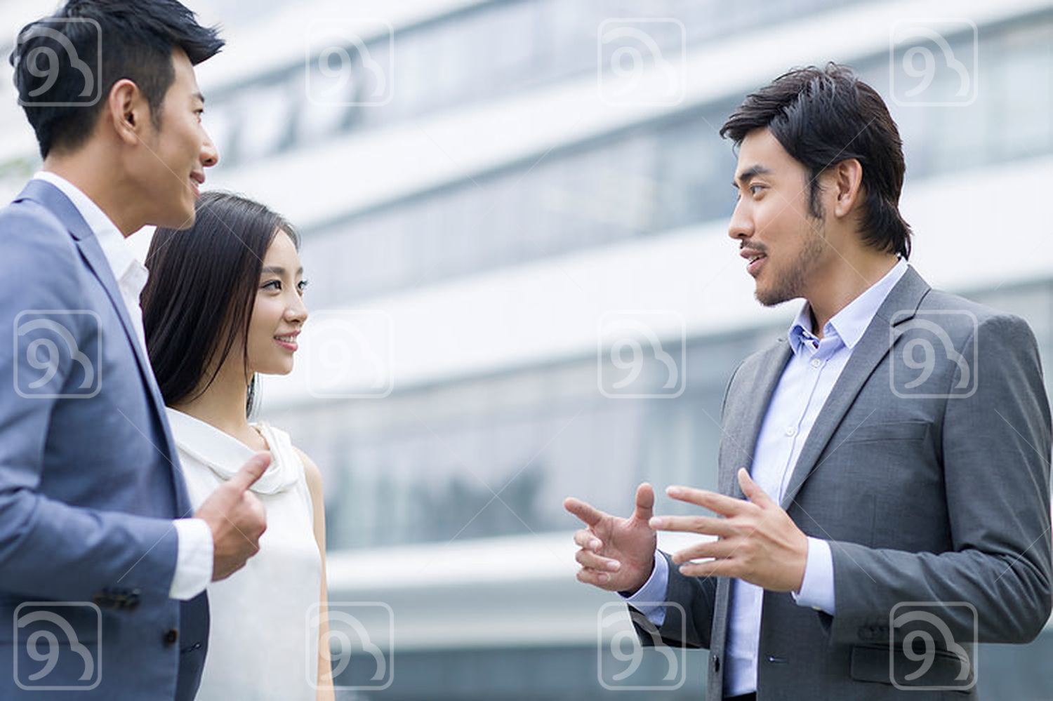 Chinese businesspeople talking outdoors