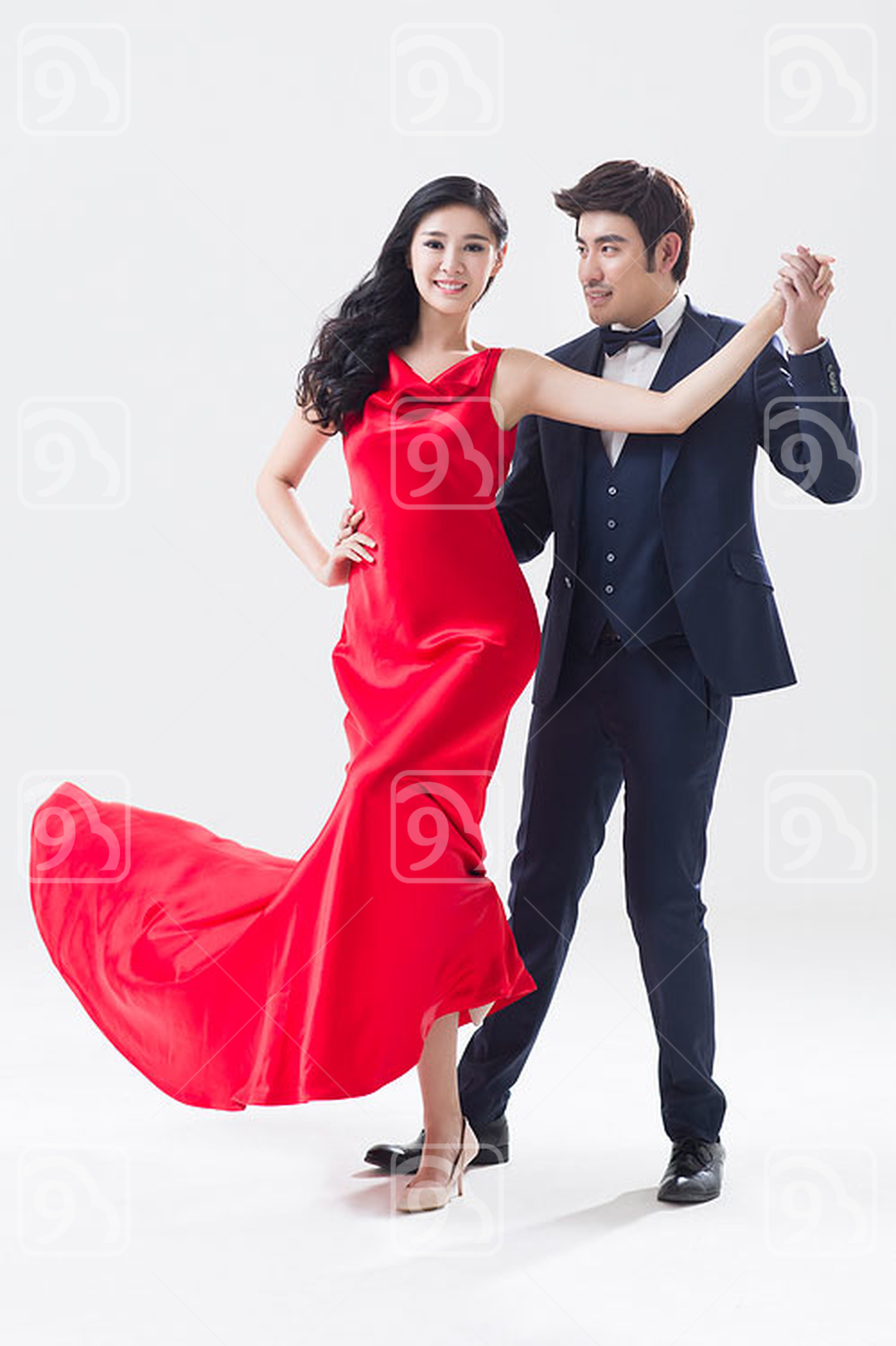 Elegant young Chinese couple dancing