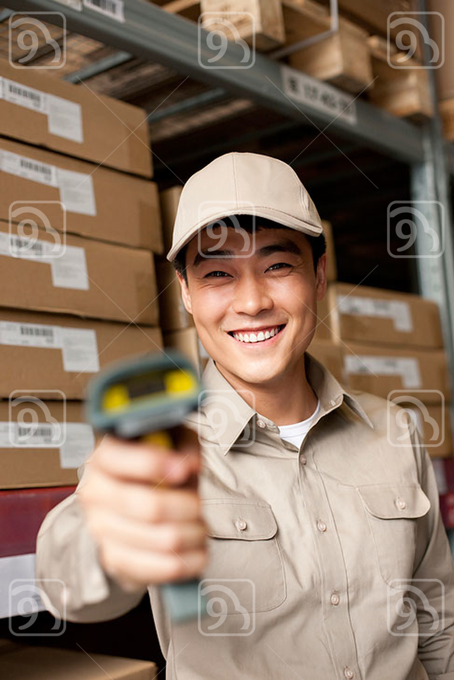 Male Chinese warehouse worker with scanner
