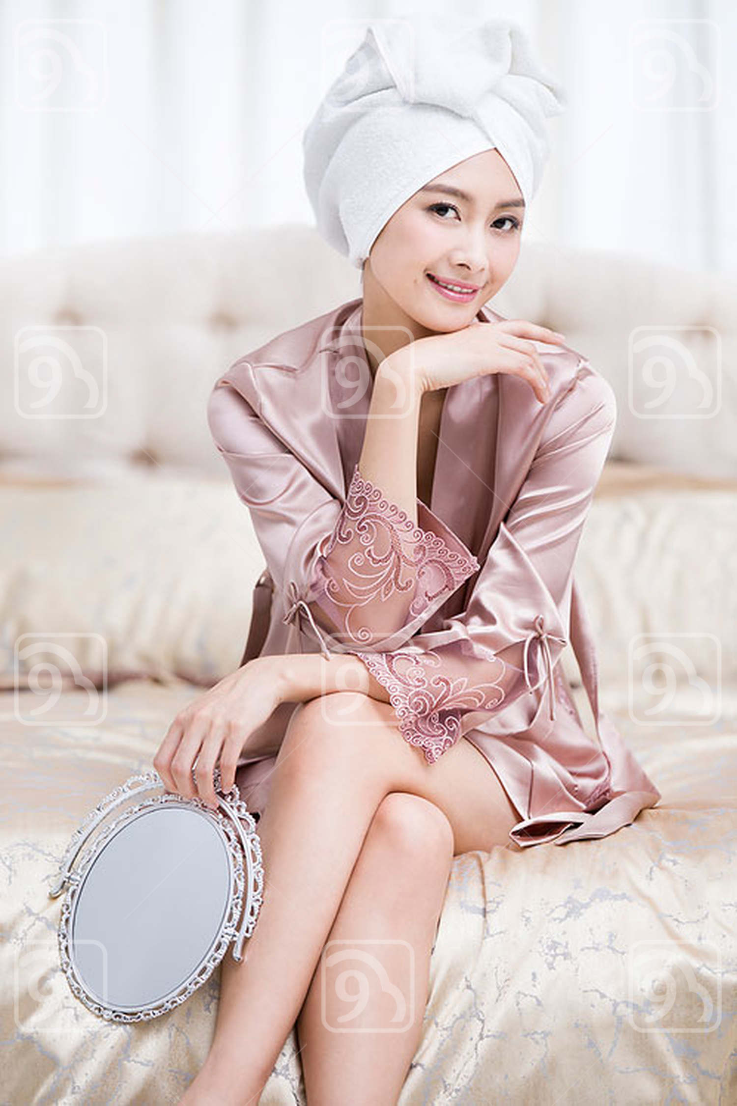 Beautiful young Chinese woman with mirror