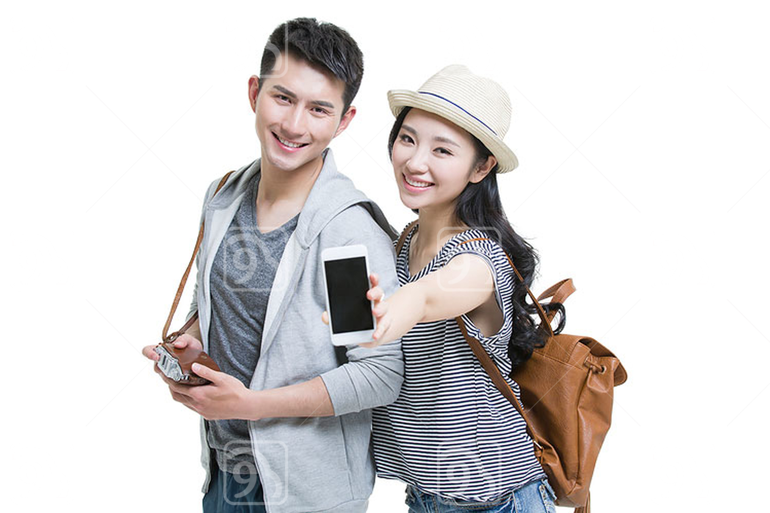 Happy young Chinese couple traveling with smart phone and camera