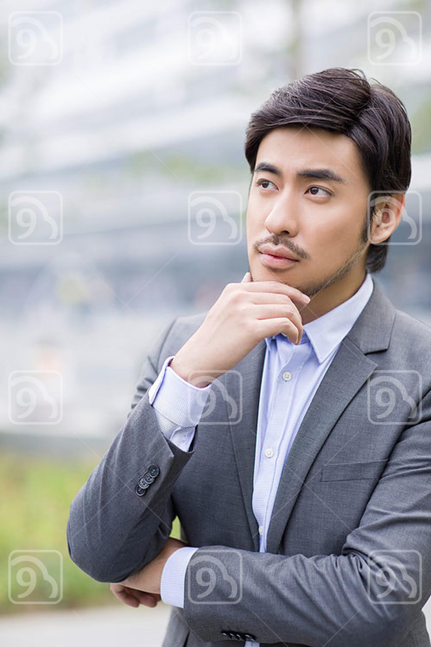 Chinese businessman thinking