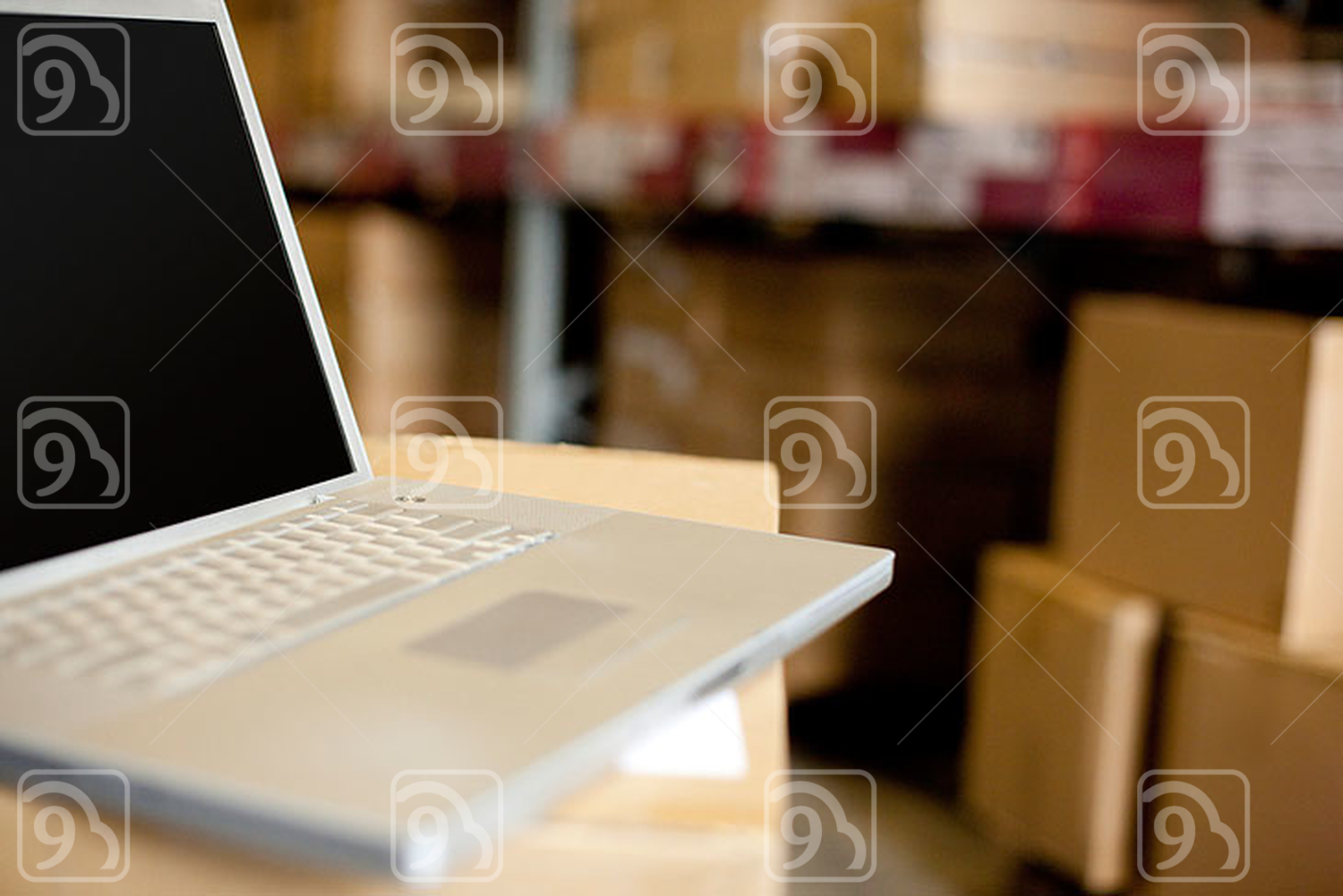Laptop in a warehouse