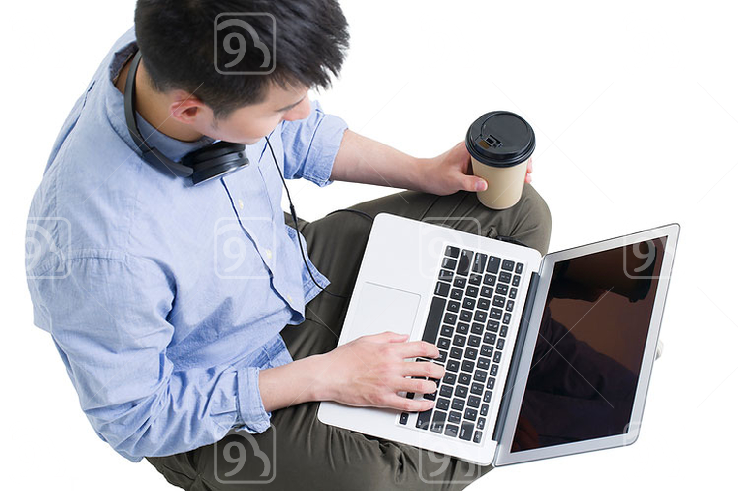 Young Chinese man using laptop