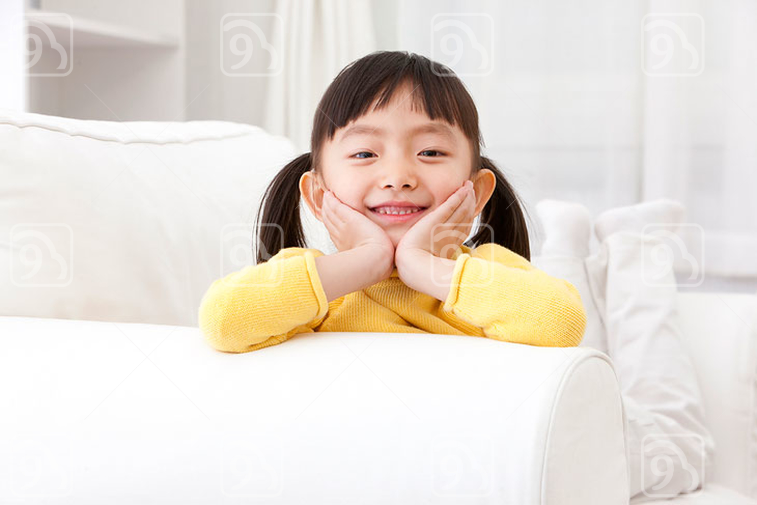 Little Chinese girl lying in couch