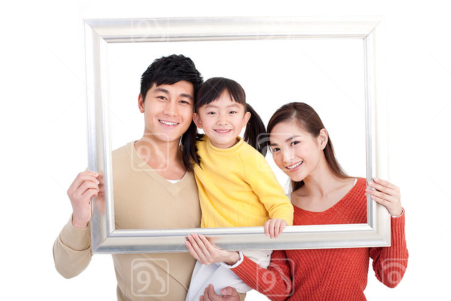 Happy Chinese young family and picture frame