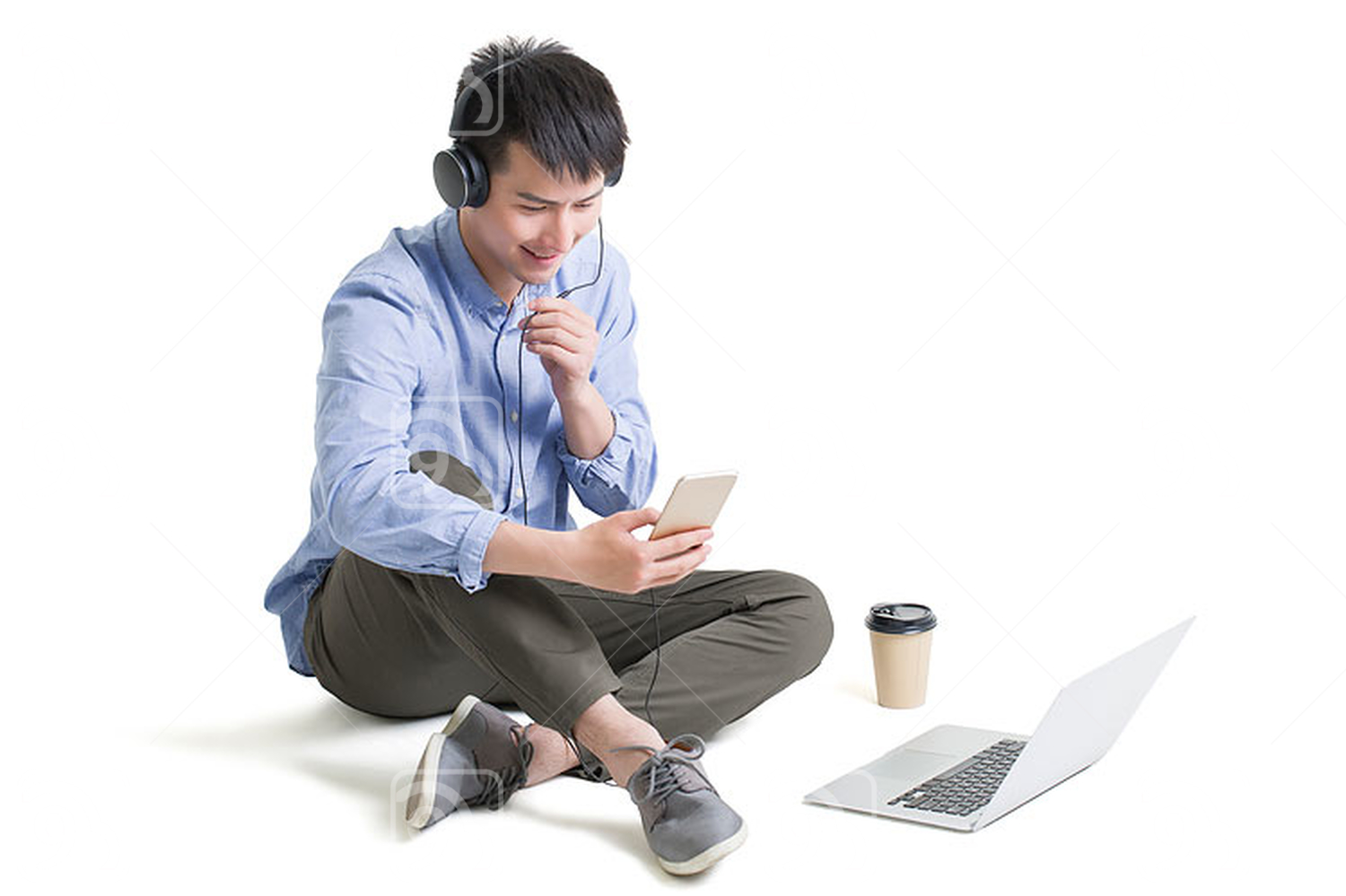 Young Chinese man with smart phone and laptop