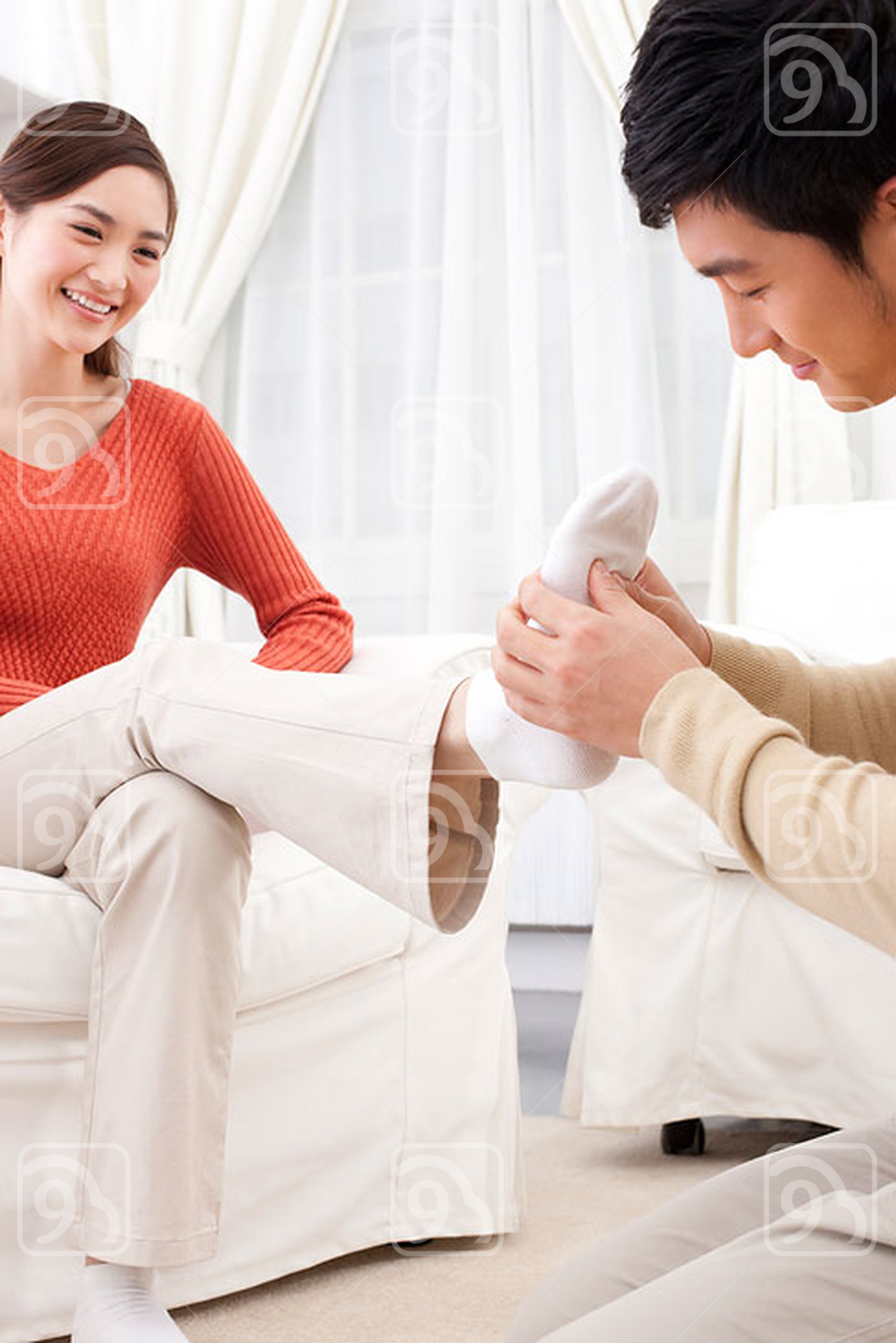 Chinese husband doing foot message for his wife