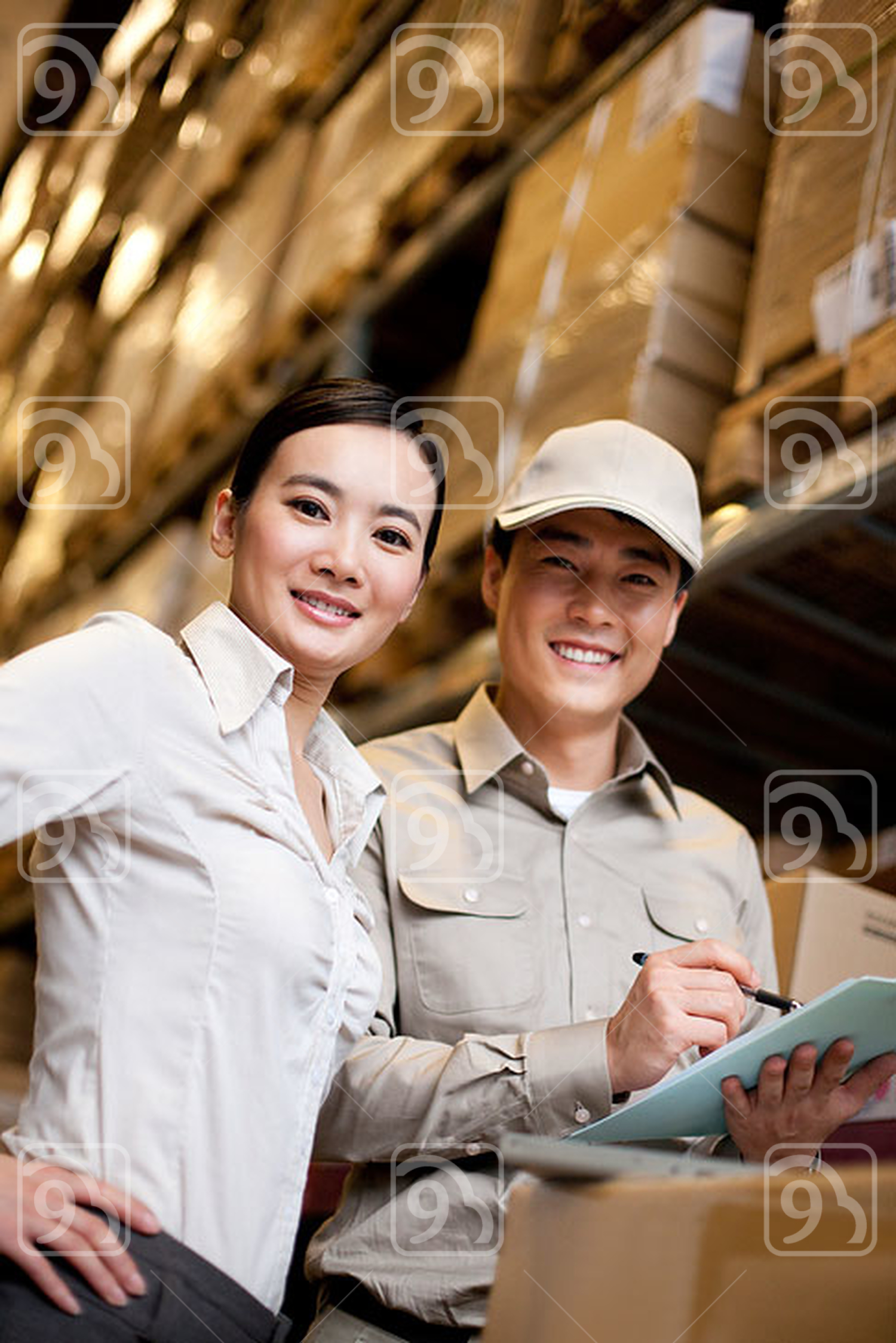 Chinese businesswoman in a warehouse with worker