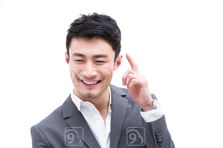 Fashionable Chinese businessman raising finger up