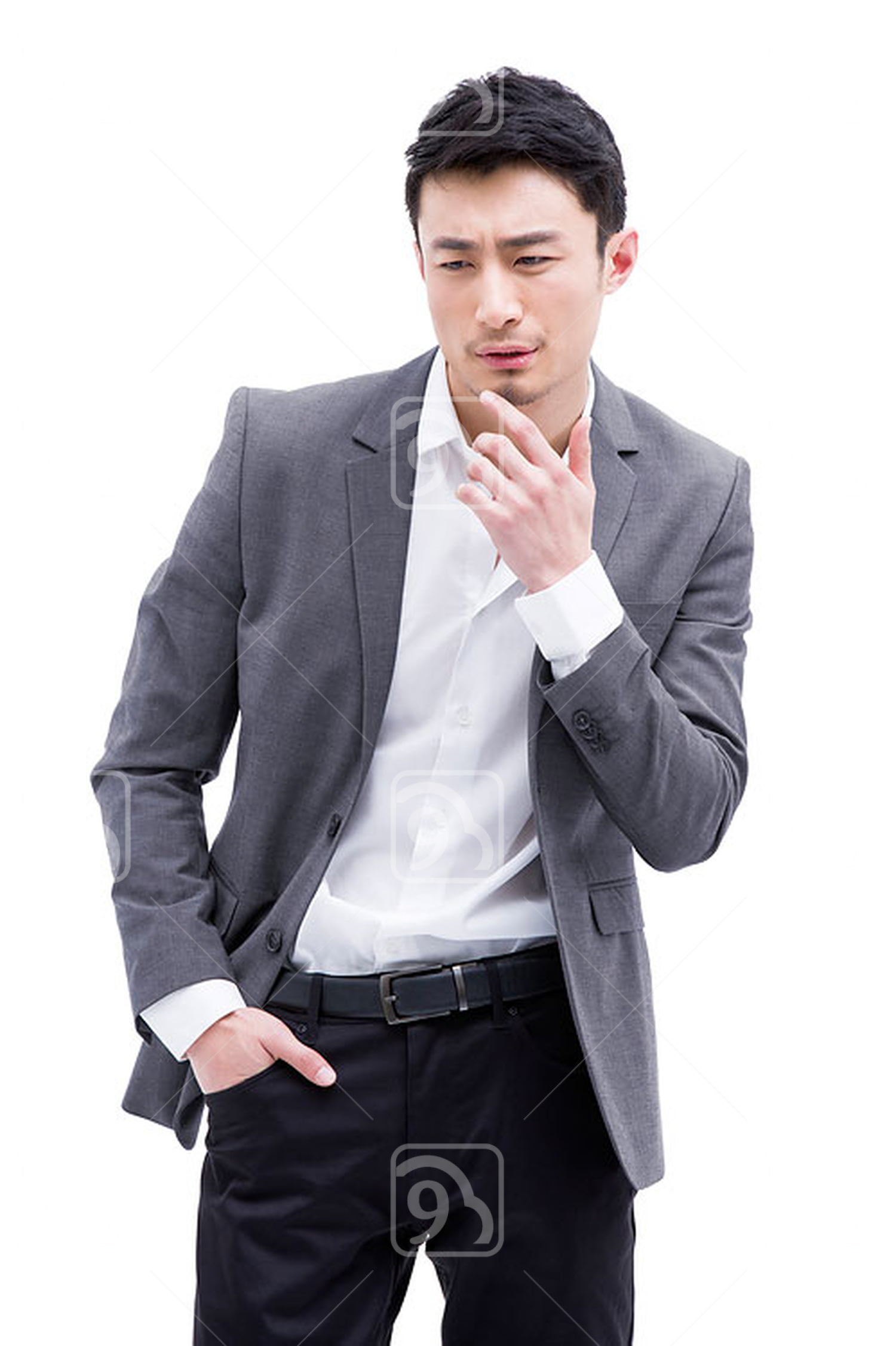 Fashionable Chinese businessman hand on chin