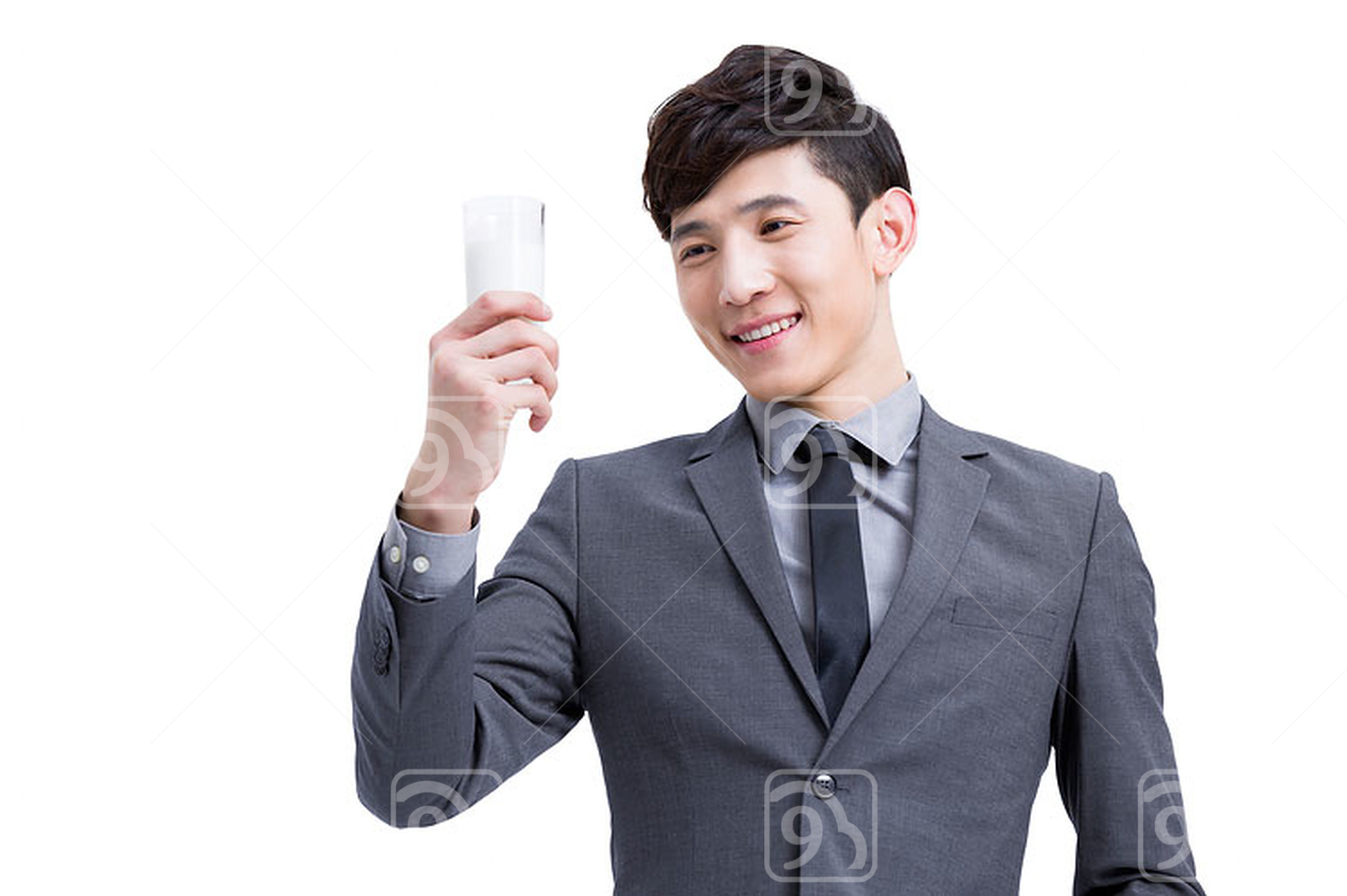 Happy Chinese businessman with milk