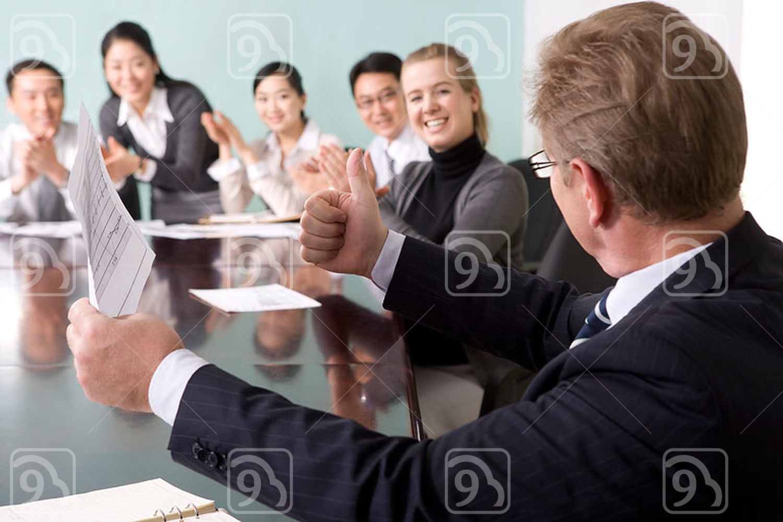 Businesspeople cheering
