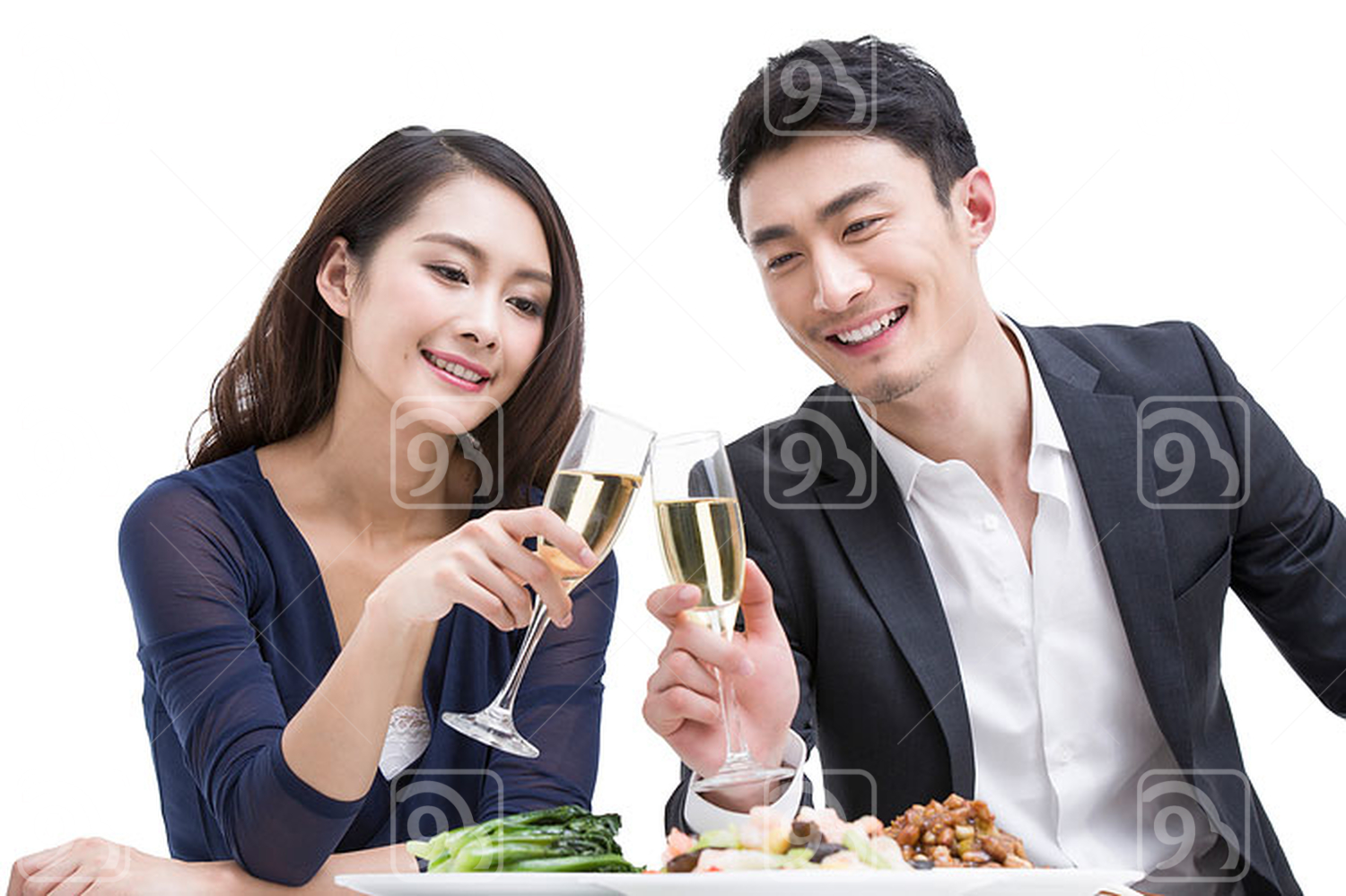 Happy young Chinese couple toasting champagne flutes