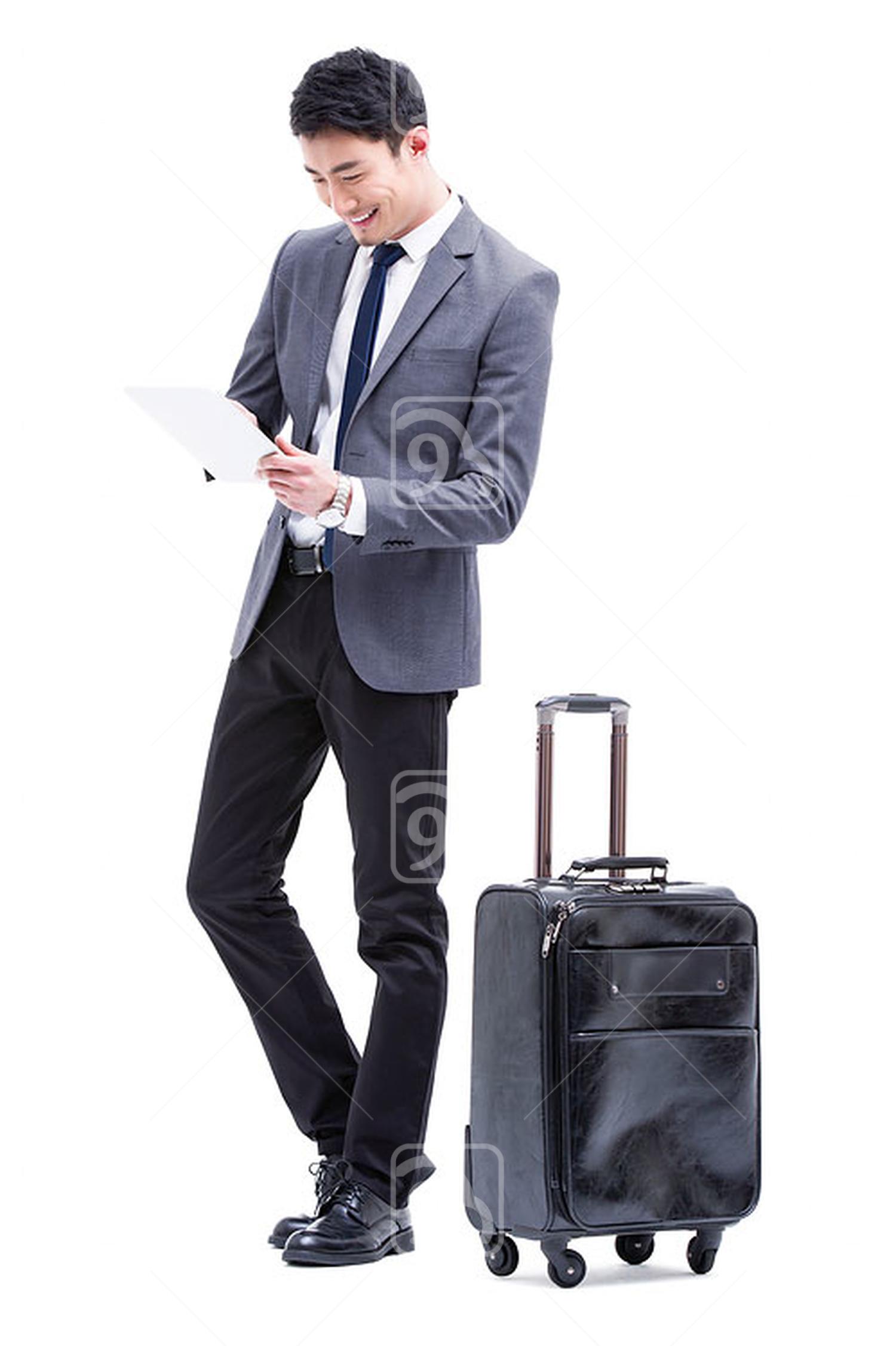 Fashionable Chinese businessman using digital tablet