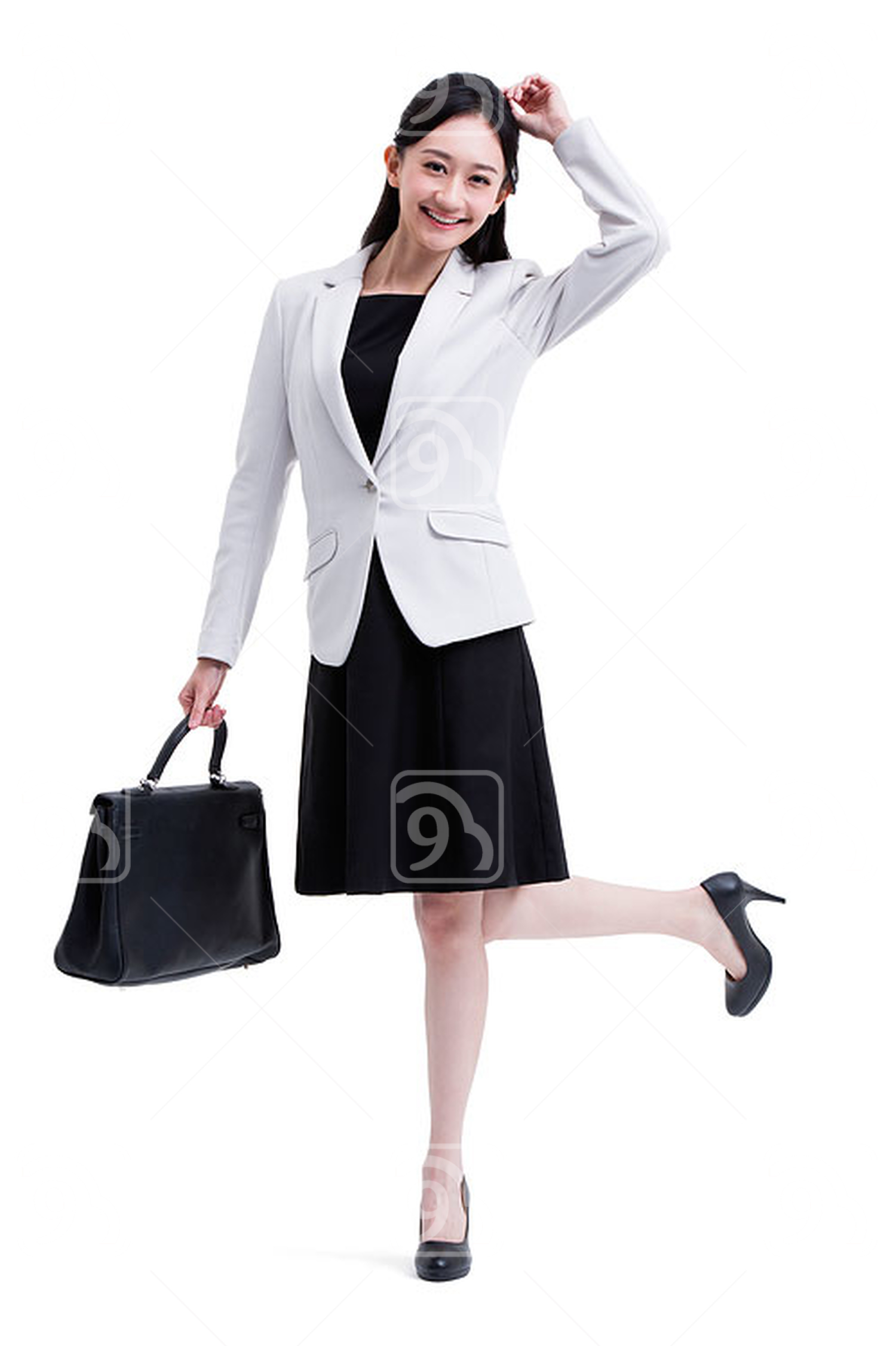 Cheerful Chinese businesswoman with briefcase in hand