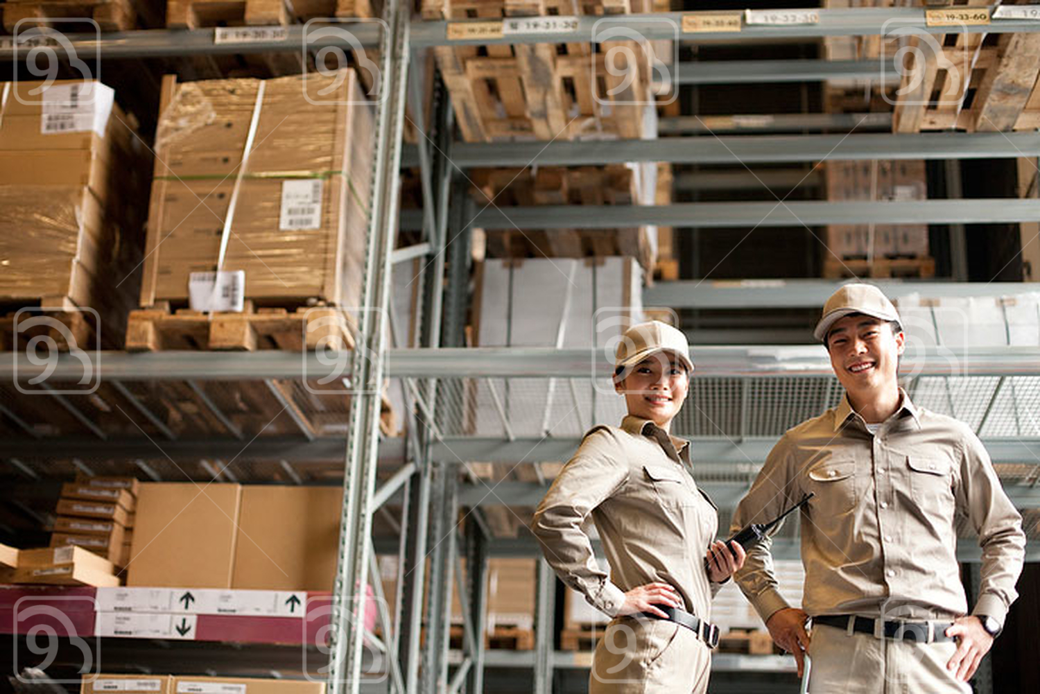 Male and female Chinese warehouse worker