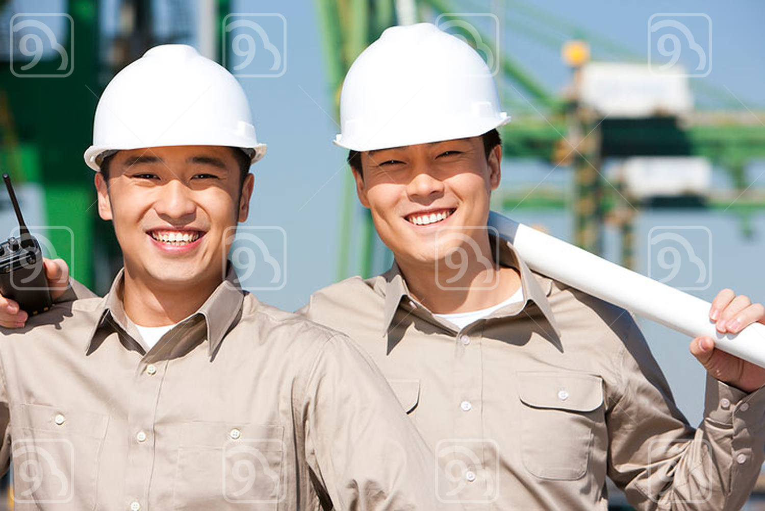 Male Chinese shipping industry workers smiling