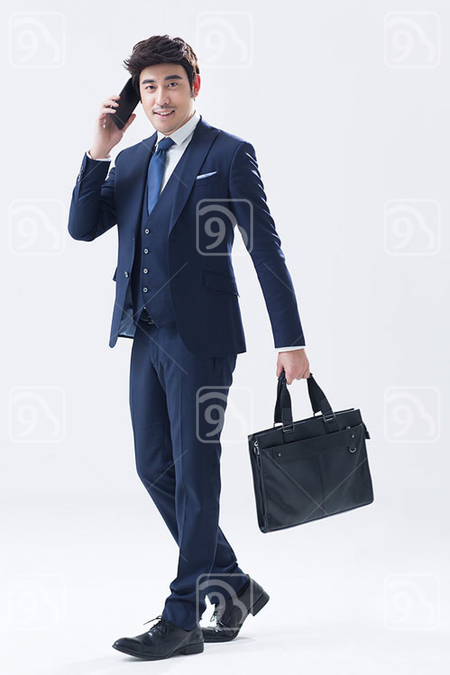 Young Chinese businessman talking on the phone