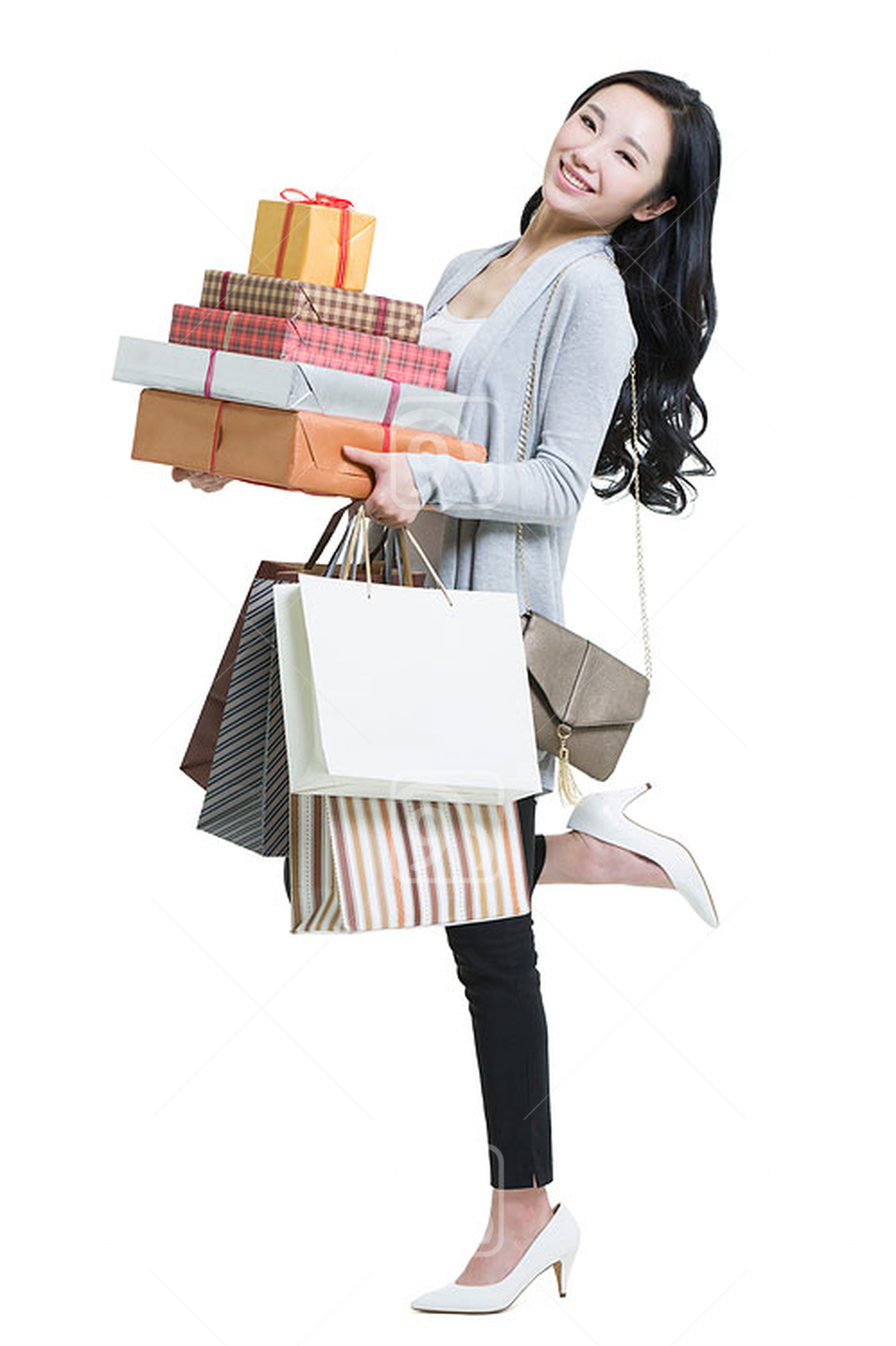 Young Chinese woman shopping with large group of boxes in hand