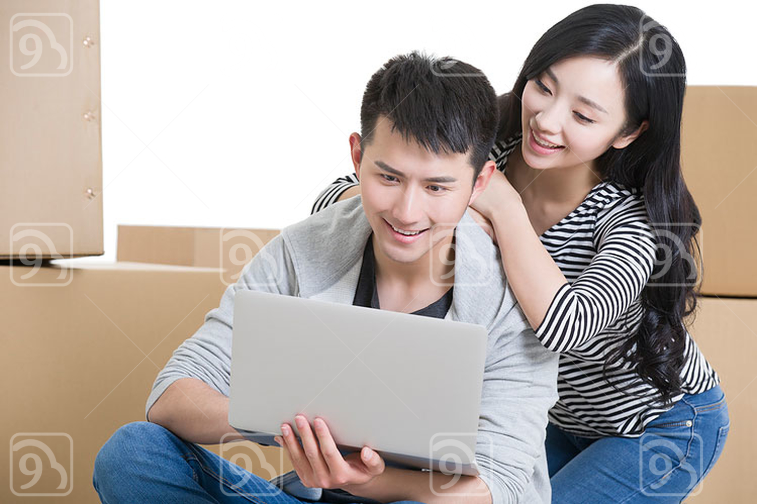 Young Chinese couple using laptop
