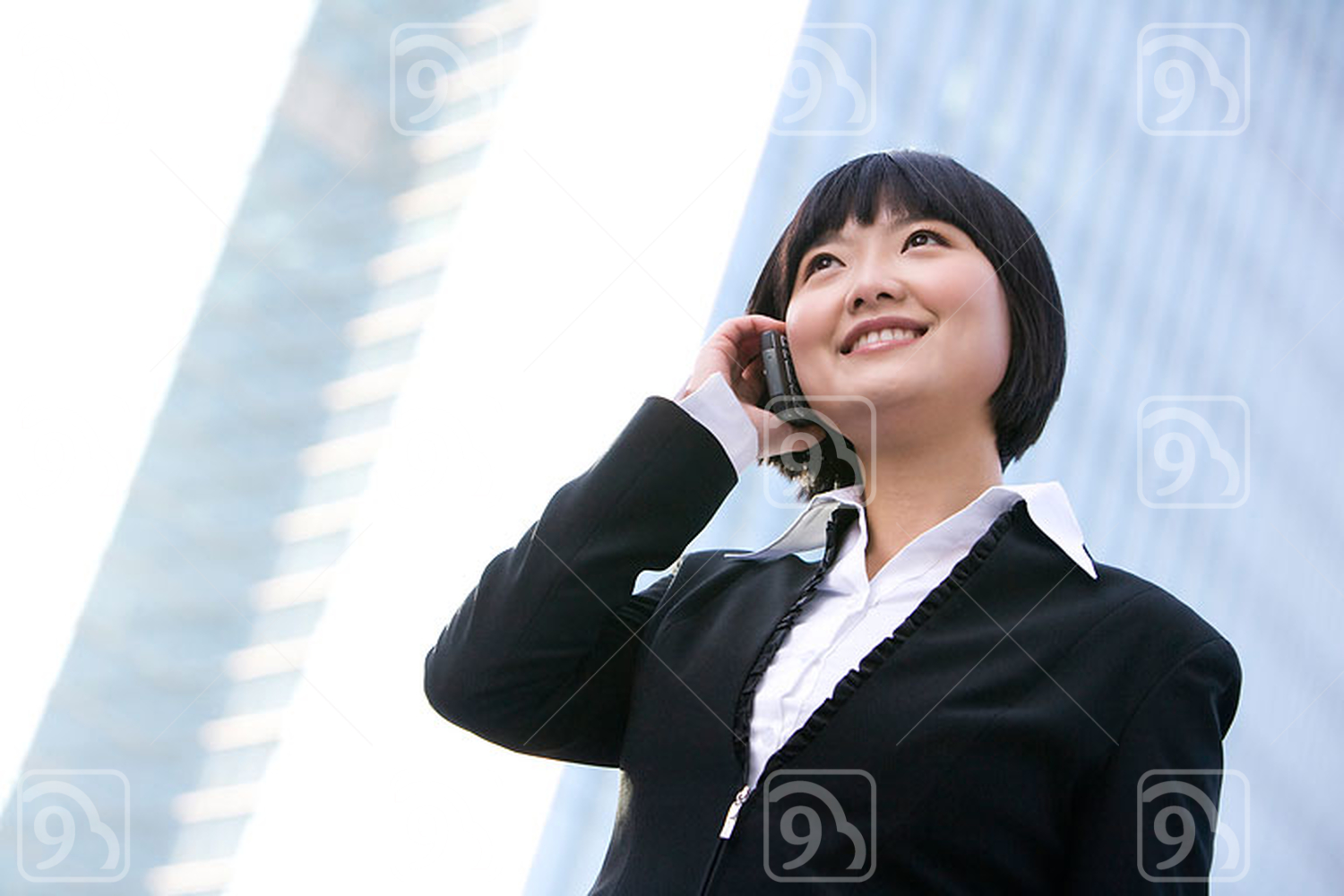 Chinese businesswoman using cellphone