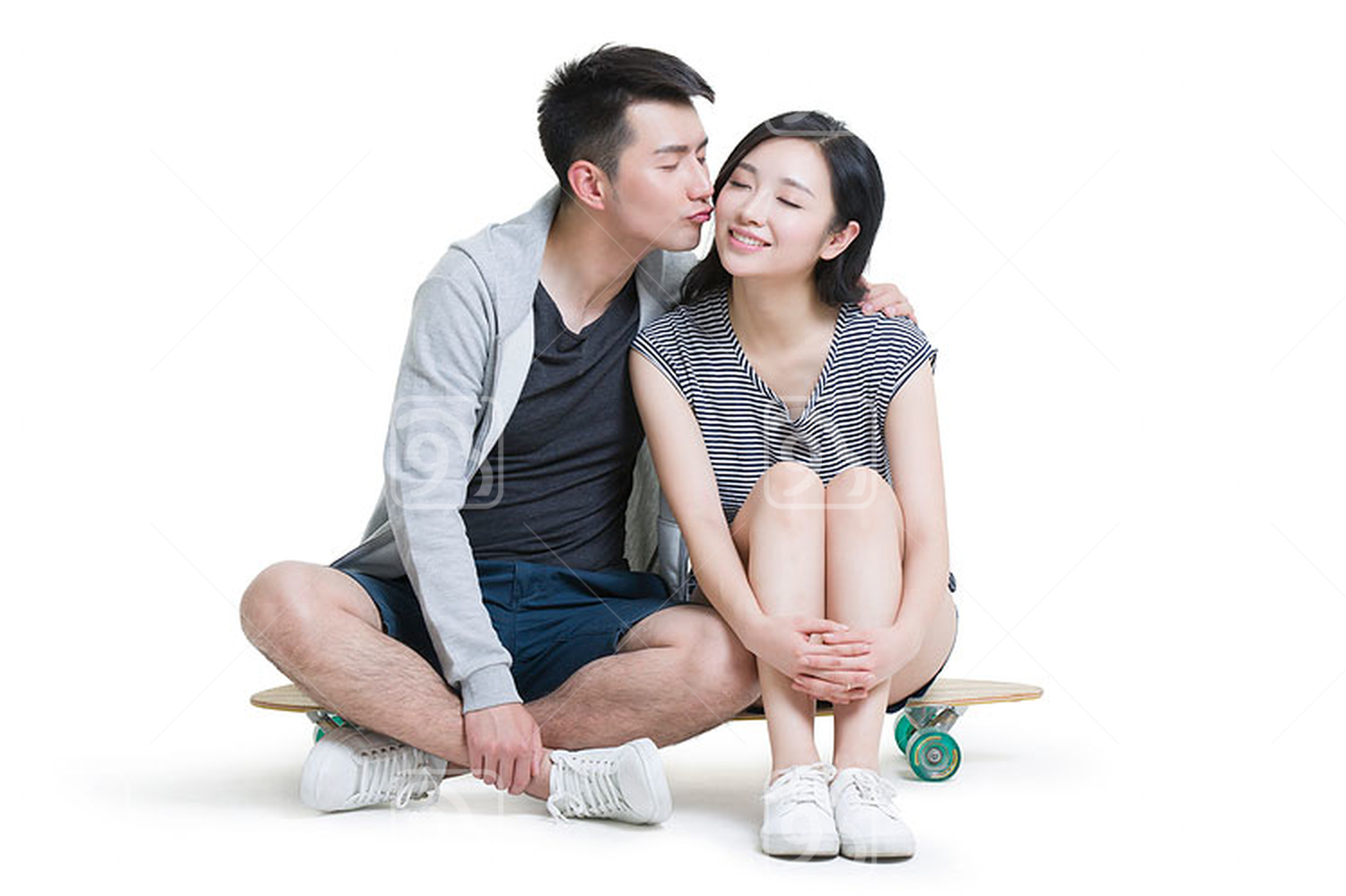 Happy young Chinese couple kissing