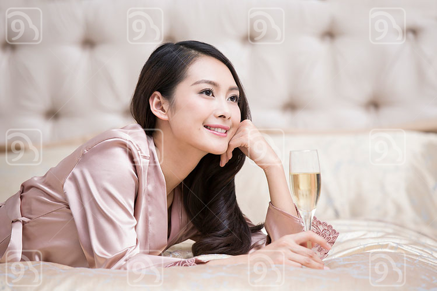 Young Chinese woman with champagne