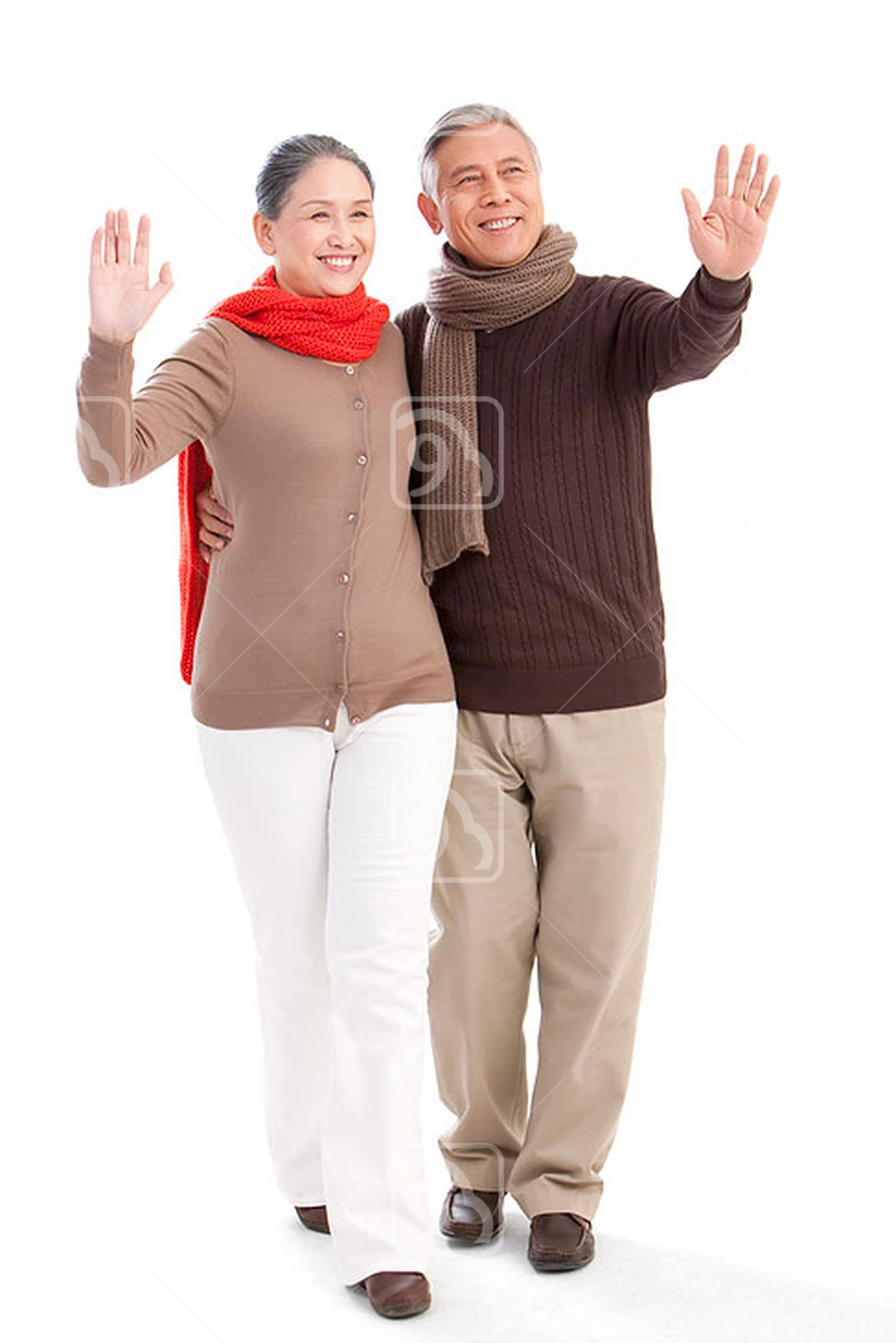 Senior Chinese couple waving hands
