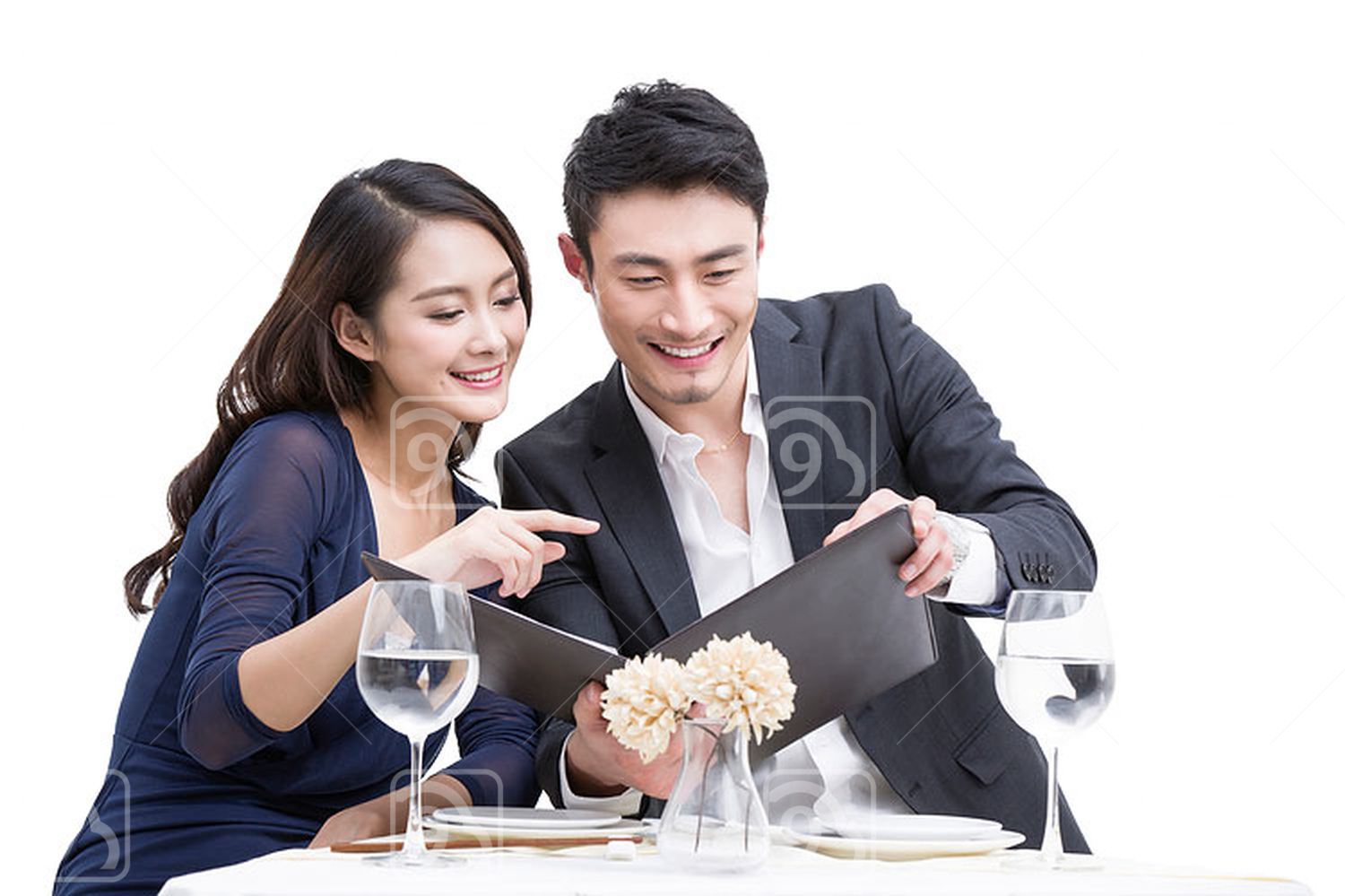 Young Chinese couple reading menu in restaurant