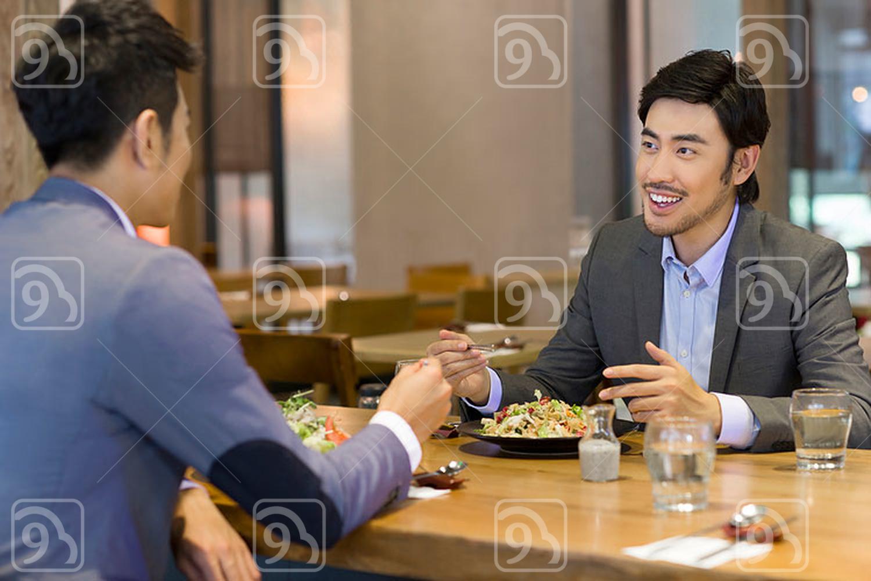 Chinese businessmen having dinner together